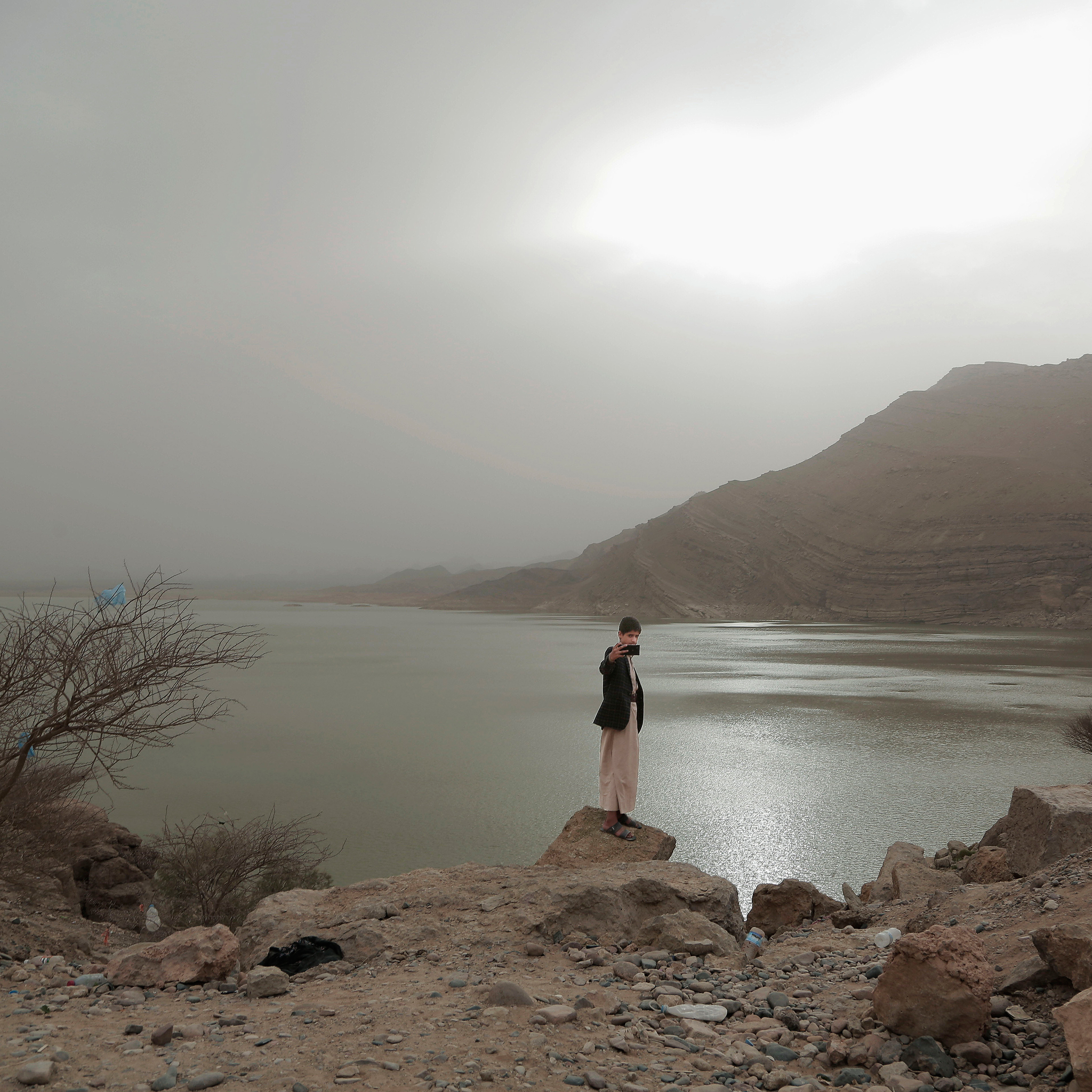 A boy takes a selfie at the Marib Dam on July 30.