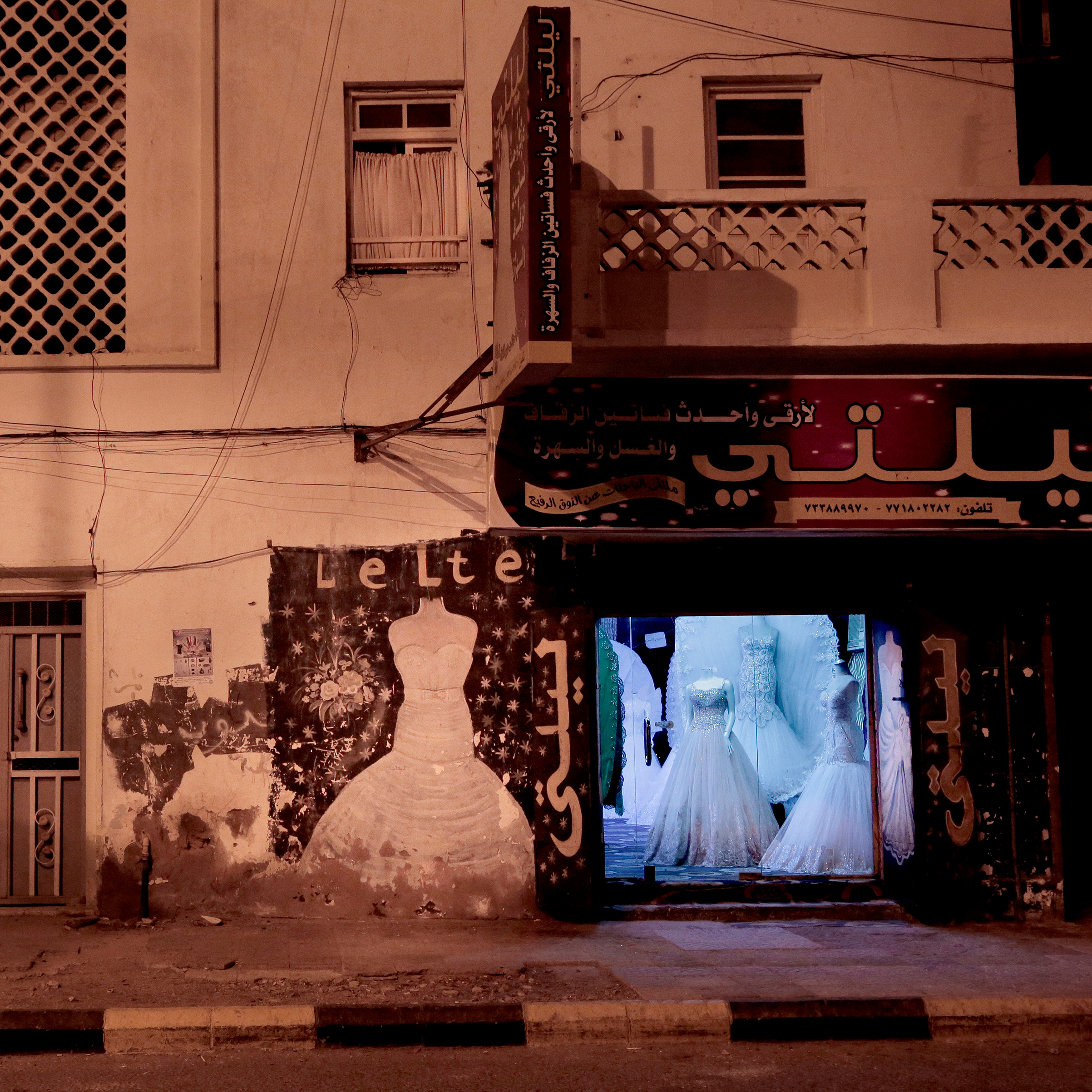 Damage outside a boutique for wedding dresses on a street in Aden on Feb. 15, 2018.