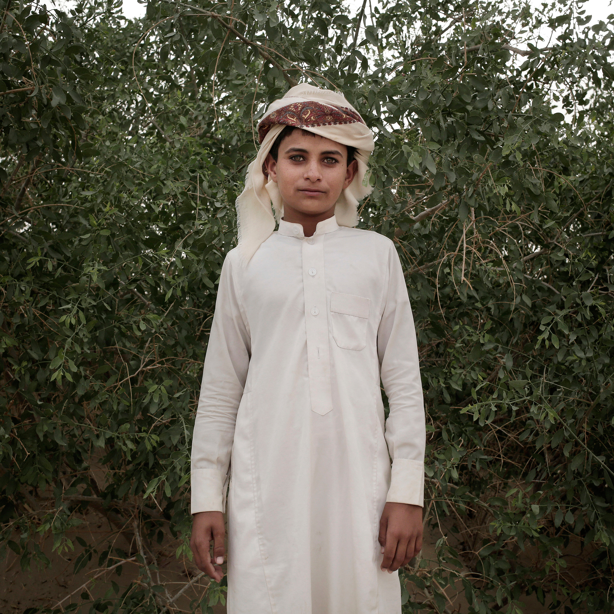 A boy poses at a displaced persons camp in Marib on July 29.