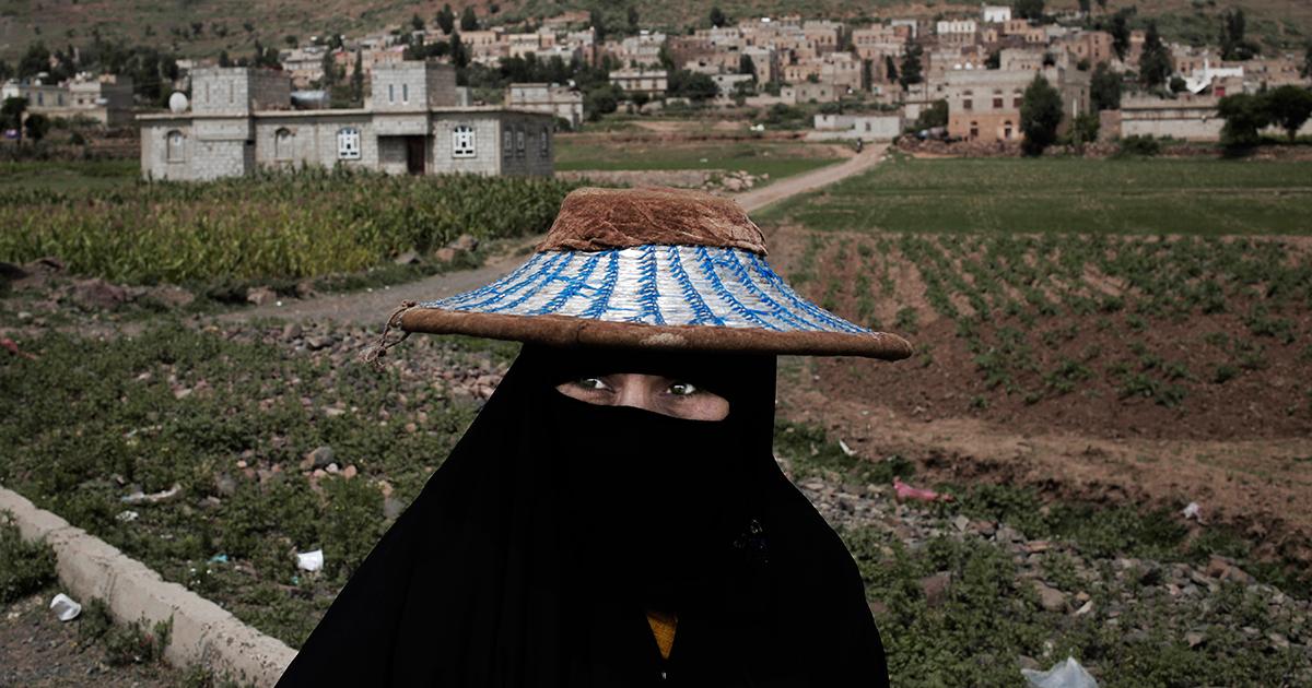 A woman walks through Ibb, south of Sana'a, on Aug. 3.