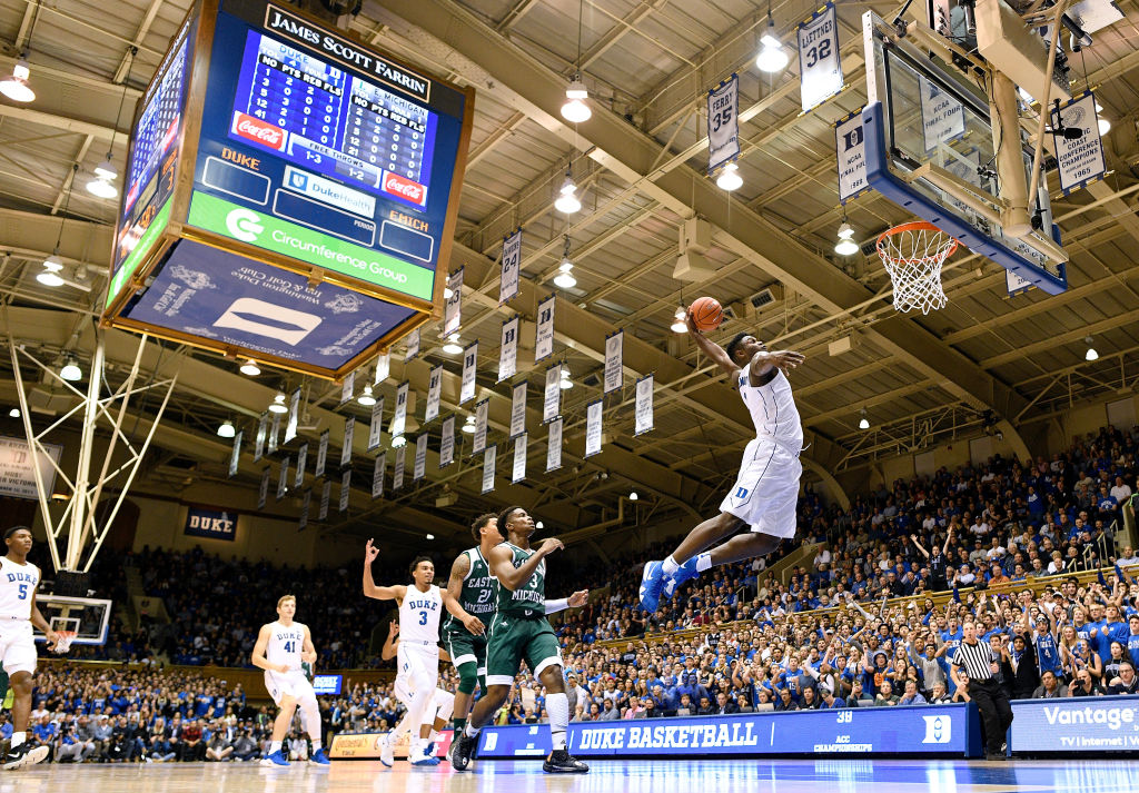 Zion Williamson #1 of the Duke Blue Devils dunks against the Eastern Michigan Eagles during the first half of their game at Cameron Indoor Stadium on November 14, 2018 in Durham, North Carolina.