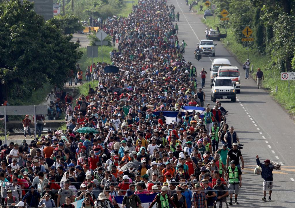 A migrant caravan walks into the interior of Mexico after crossing the Guatemalan border near Ciudad Hidalgo, Mexico on Oct. 21, 2018.