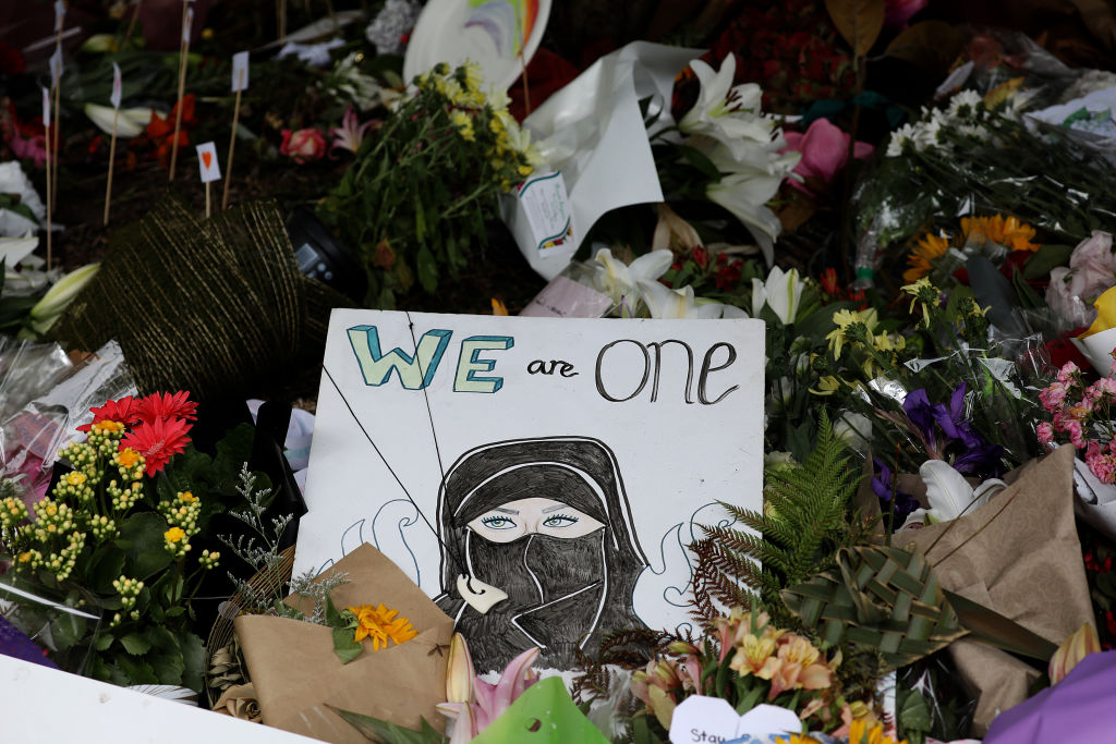 Flowers and messages of condolence to victims of the mosque attacks are seen at a memorial outside the Masjid Al Noor mosque in Christchurch, New Zealand on March 21, 2019.