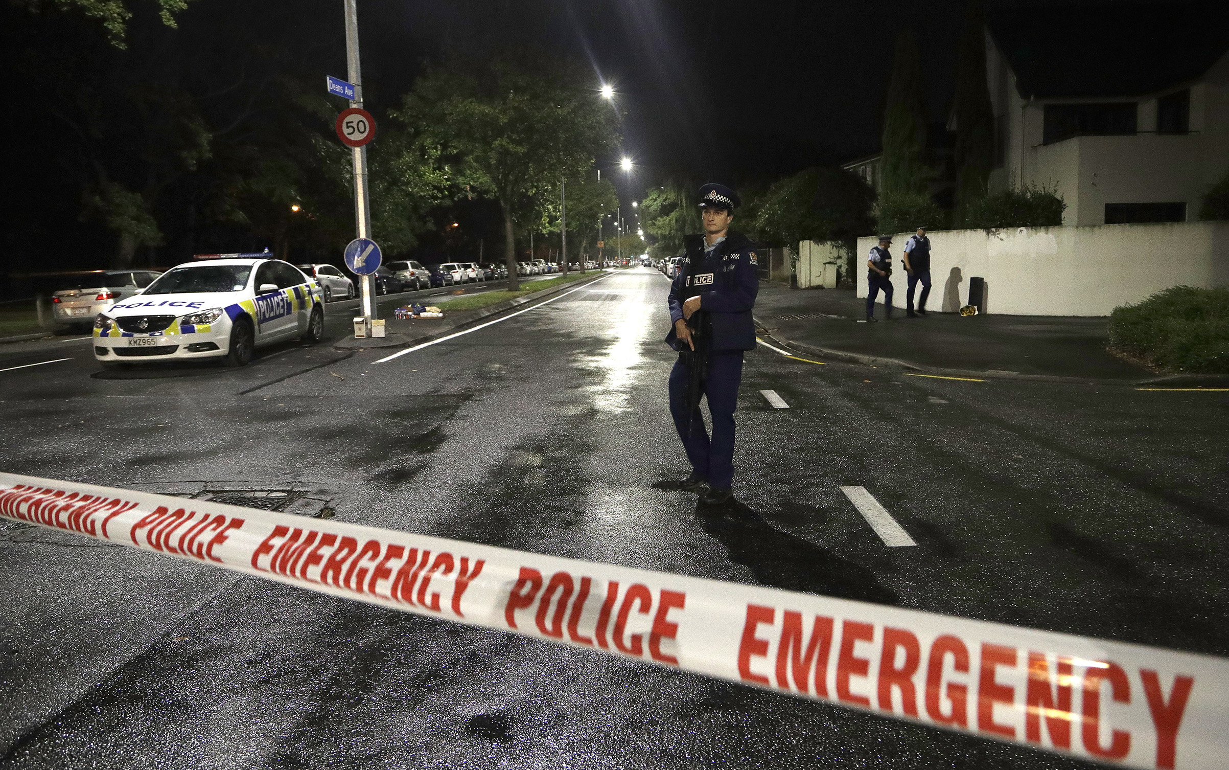 A police officer patrols at a cordon near a mosque where multiple people were killed in a mass shooting in central Christchurch, New Zealand, on March 15, 2019.