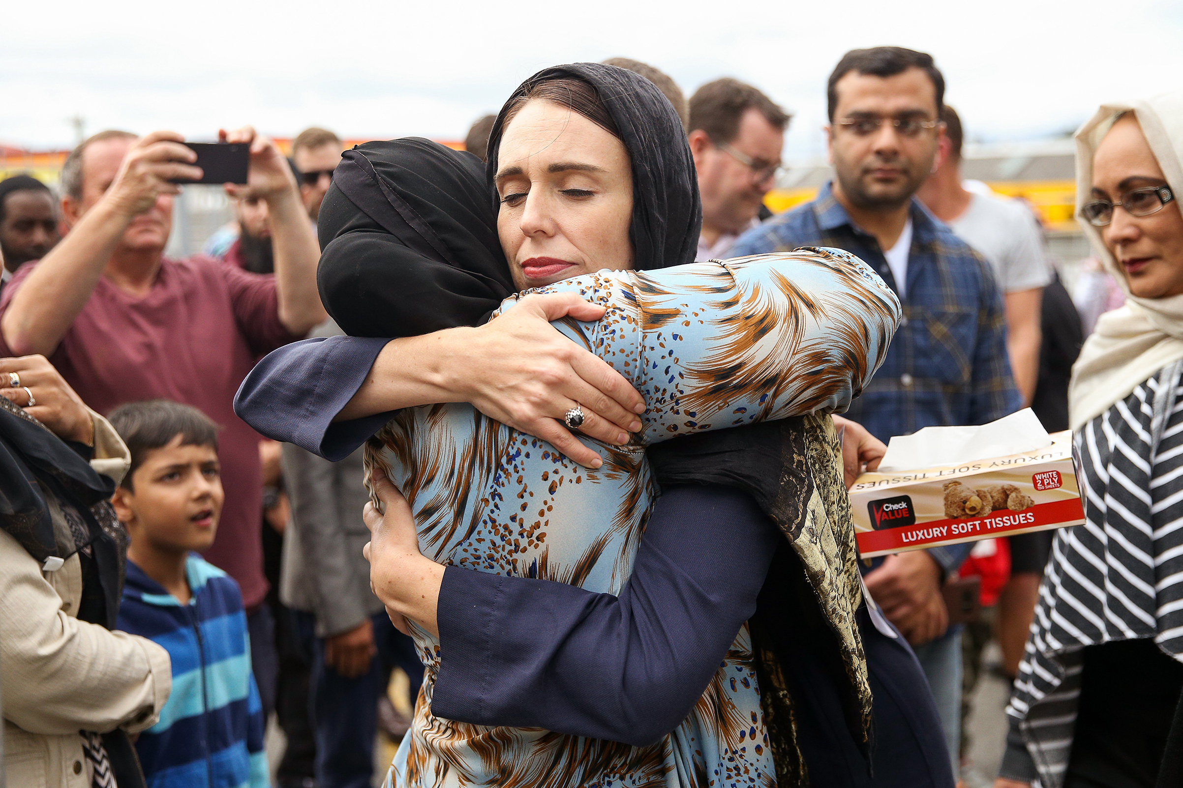 New Zealand Prime Minister Jacinda Ardern hugs a worshipper at Kilbirnie Mosque in Wellington two days after the attacks