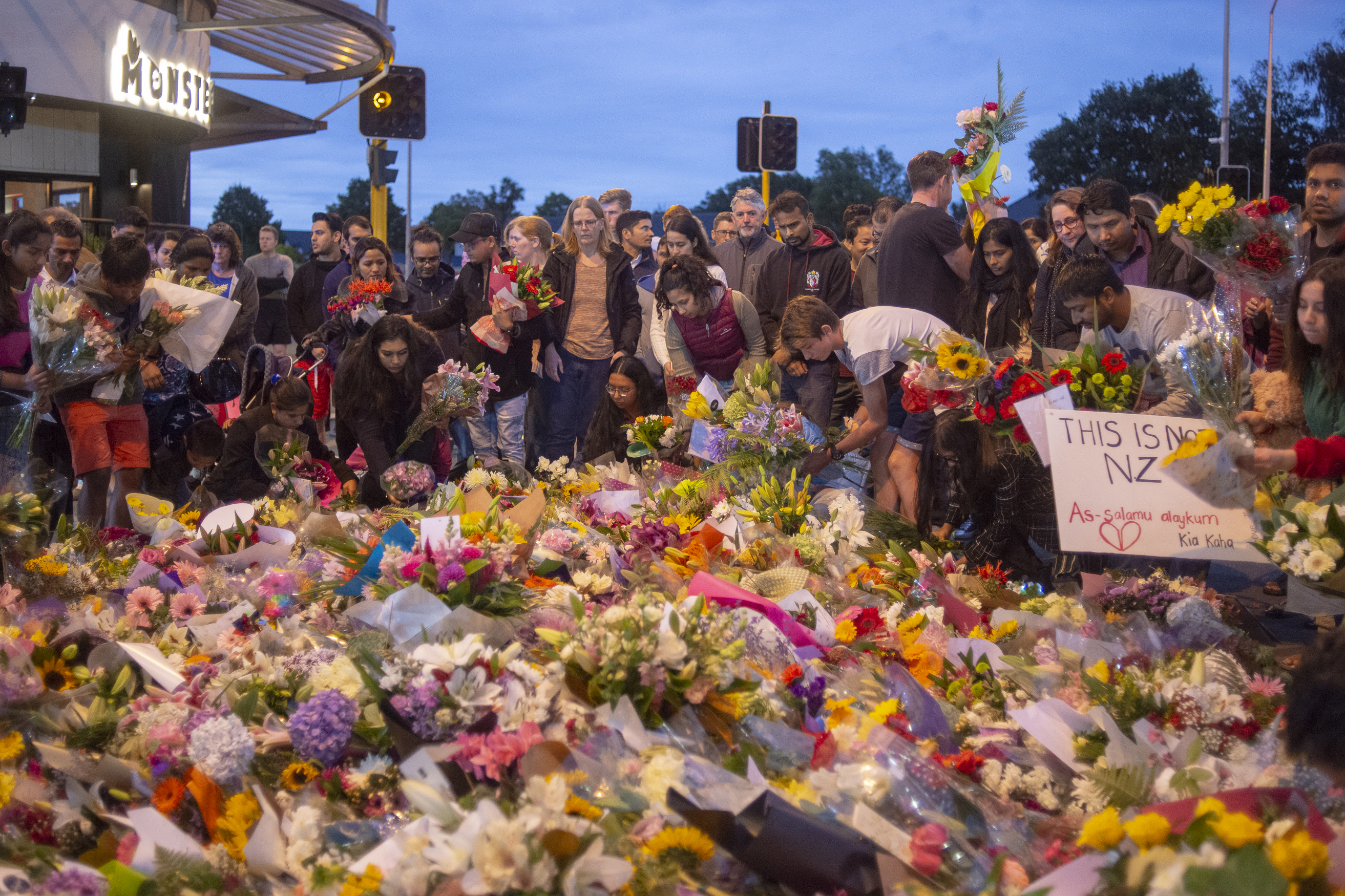 People pay their respects for victims of the March 15 mosque attacks, in Christchurch on March 16, 2019.