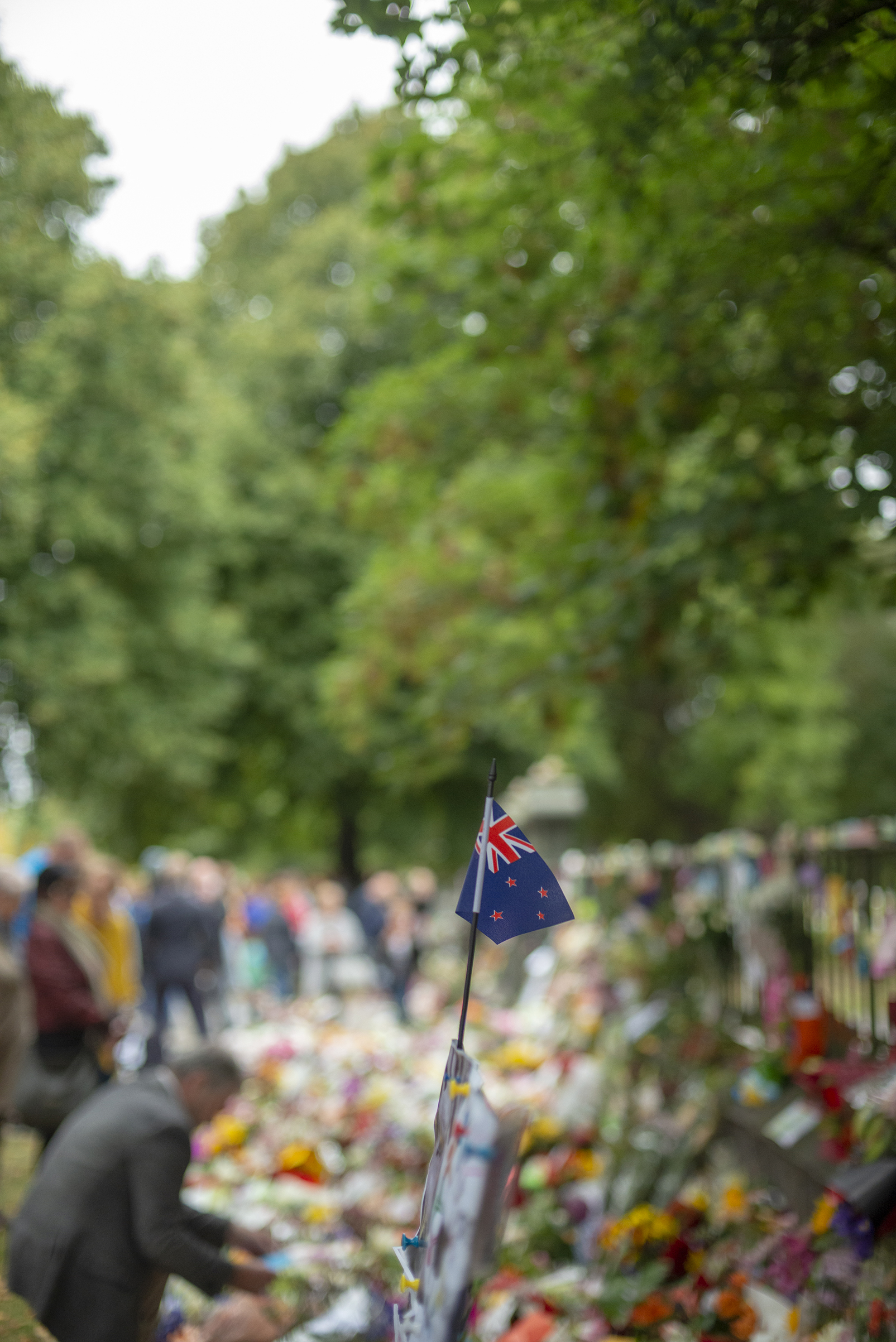 A New Zealand flag stand amidst the tributes to the shooting victims in Christchurch.