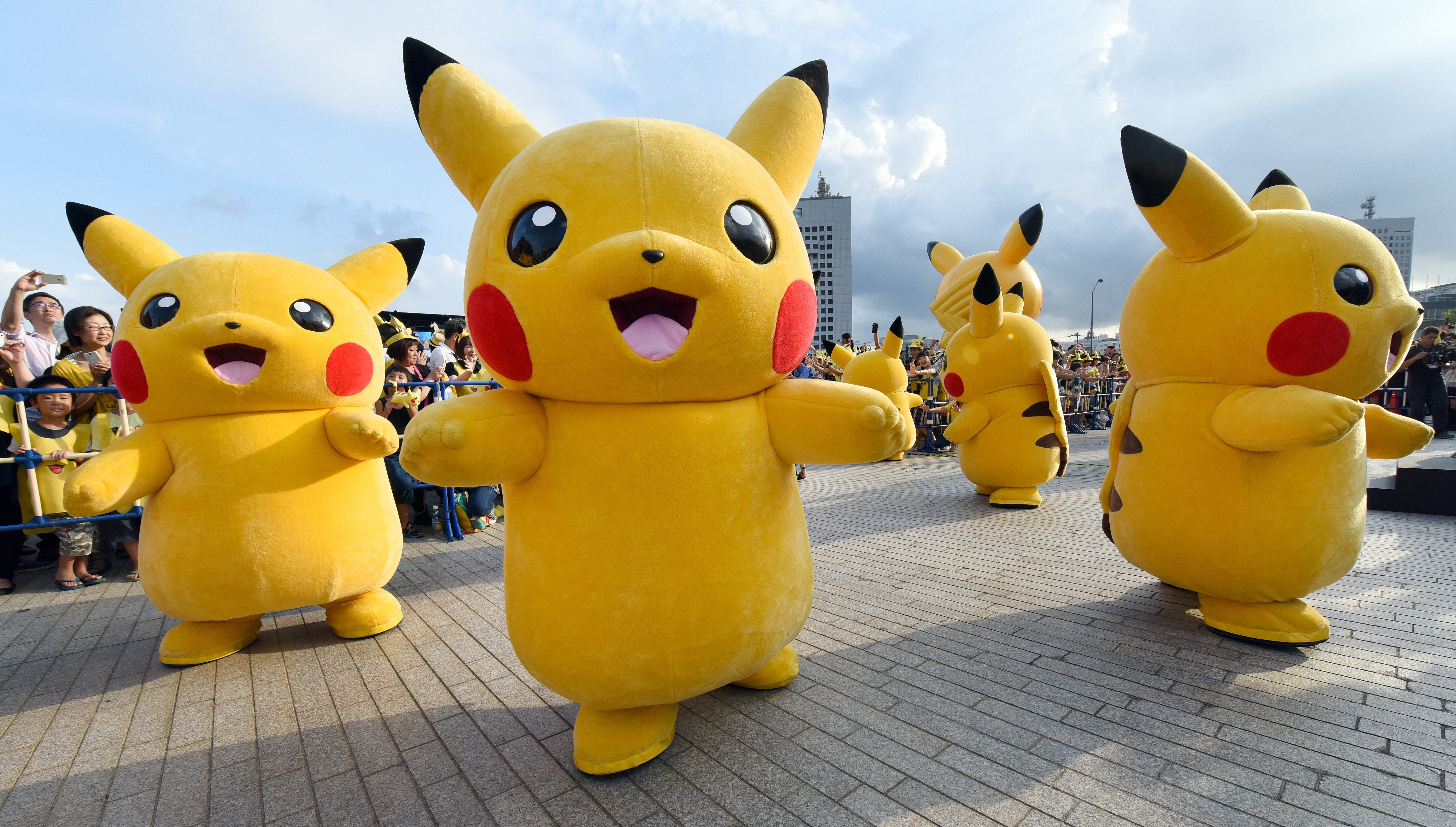 Dozens of people dressed up as Pikachu, the famous character of Nintendo's videogame software Pokemon, dance with fans as the final of a nine-day  Pikachu Outbreak  event takes place to attract summer vacationers in Yokohama, in suburban Tokyo, on August 16, 2015.