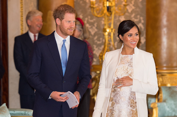 Meghan, Duchess of Sussex and Prince Harry, Duke of Sussex attend a reception to mark the fiftieth anniversary of the investiture of the Prince of Wales at Buckingham Palace in London on March 5, 2019.