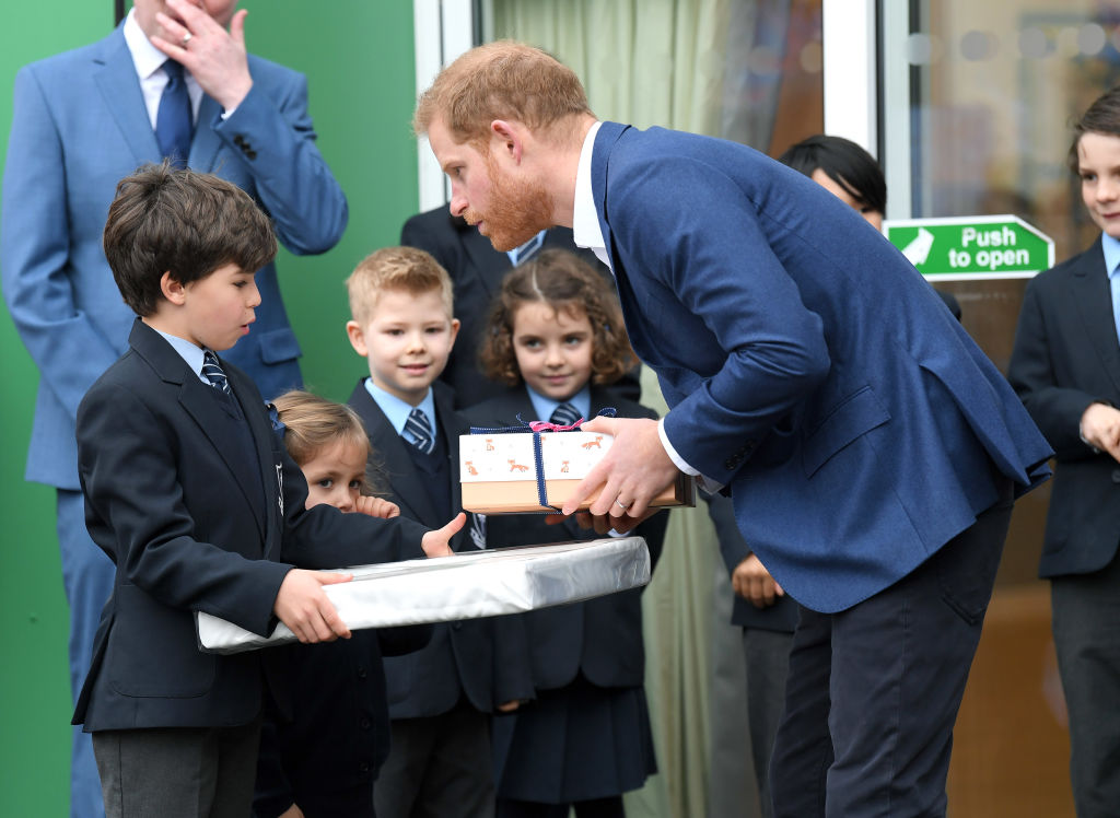 Prince Harry, Duke of Sussex departs after taking part in a tree planting project in support of The Queen's Commonwealth Canopy (QCC) initiative, together with the Woodland Trust at St Vincent's Catholic Primary School on March 20, 2019 in Acton, England.