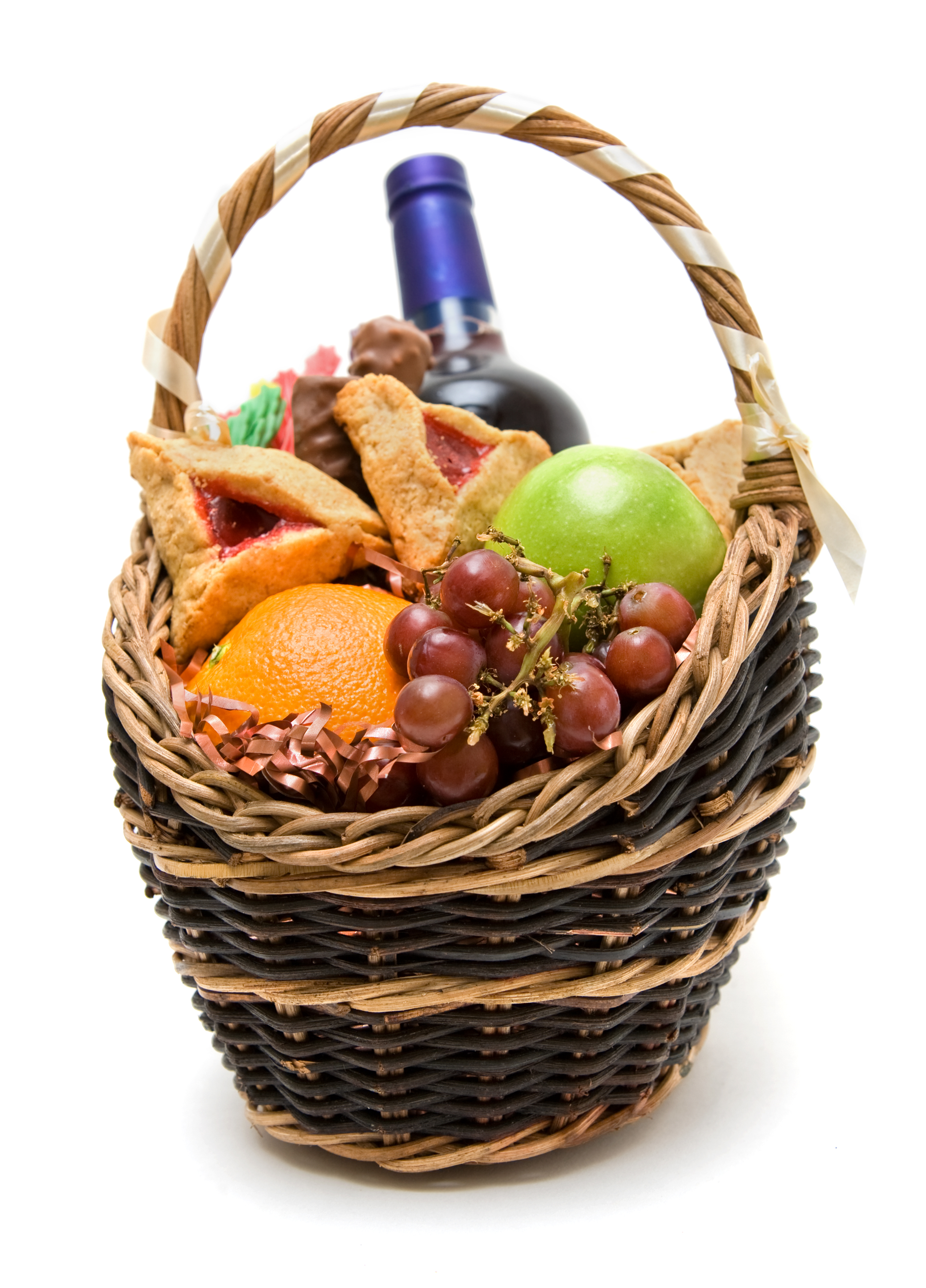 Purim basket with fruit, candy, wine and hamentaschen.