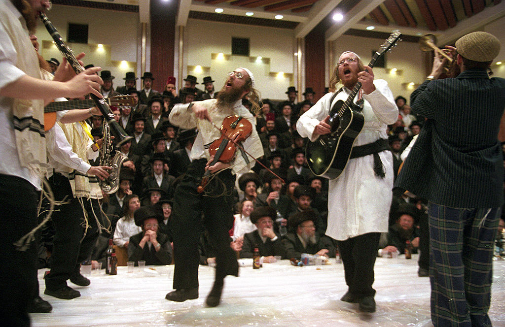 Ultra Orthodox Jews from the Tzanz Hassidim group perform a Purim play at the synagogue in Netanya, Israel, north of Tel Aviv on March 14, 2006.