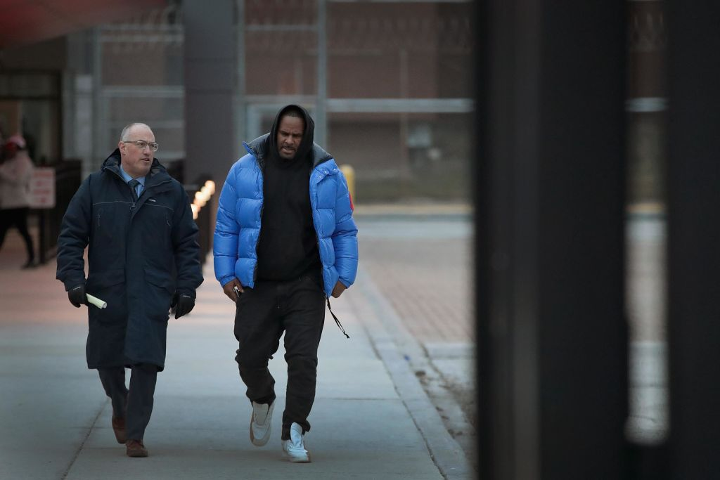 R&B singer R. Kelly (R) and his attorney Steve Greenberg leave Cook County jail after Kelly posted $100 thousand bond on Feb. 25, 2019 in Chicago, Illinois.