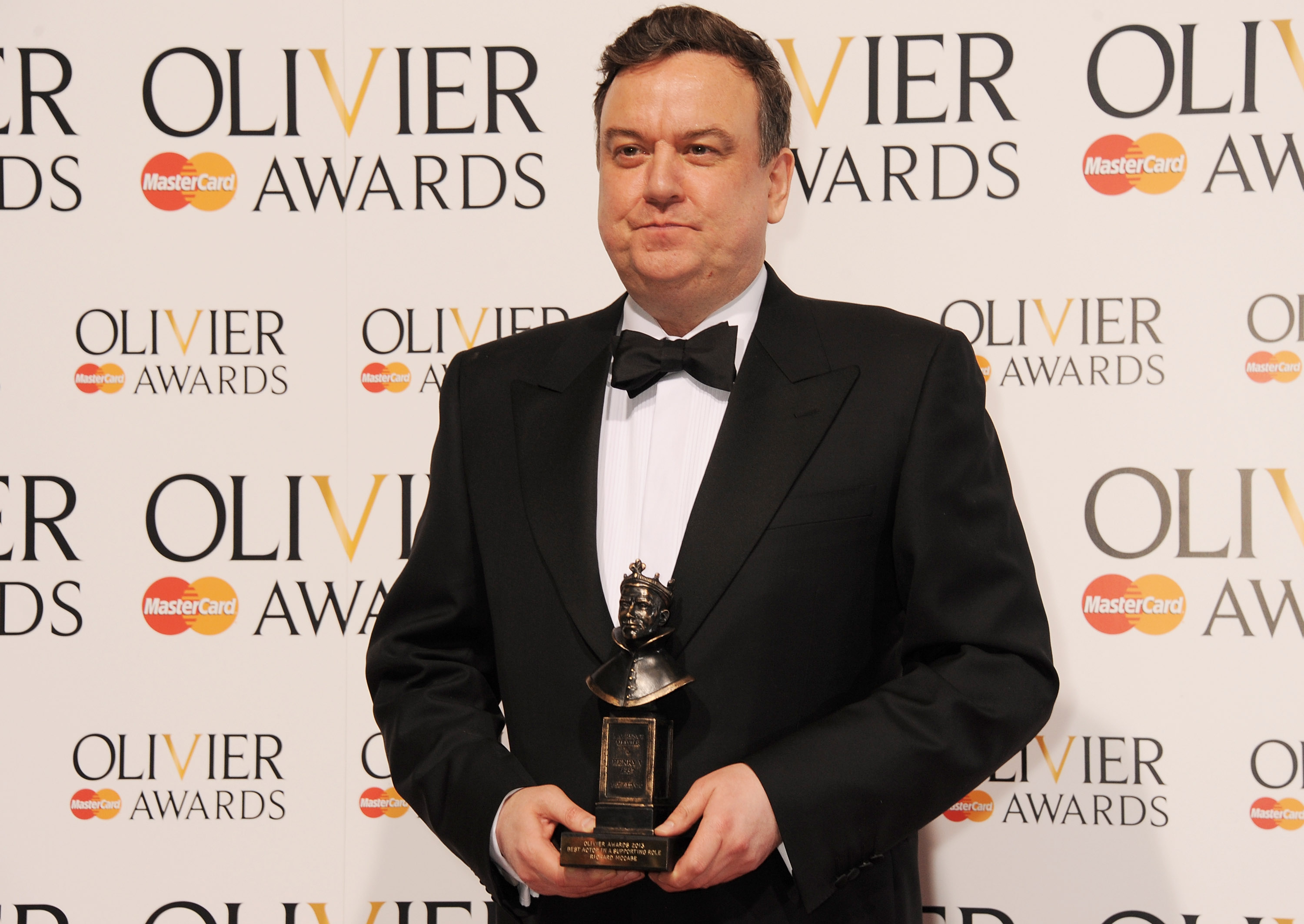 Richard McCabe, winner of Best Actor in a Supporting Role, poses in the press room at The Laurence Olivier Awards 2013 at The Royal Opera House on April 28, 2013 in London, England.