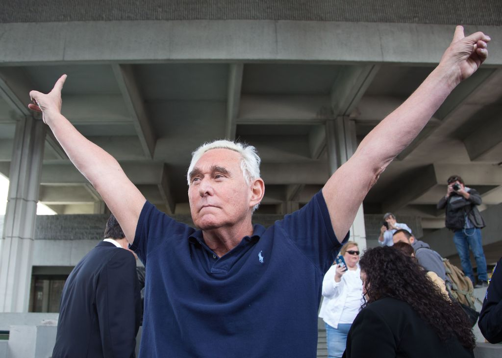 Roger Stone throws up peace signs outside court on Jan. 25, 2019 in Fort Lauderdale, Florida.