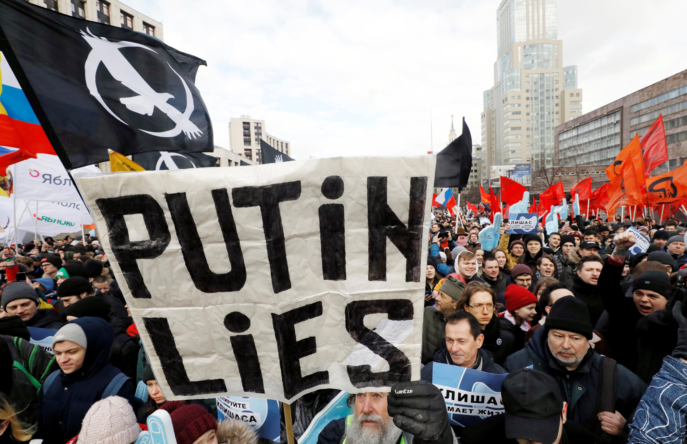 Russians protest against tightening state control over the internet in Moscow on March 10.