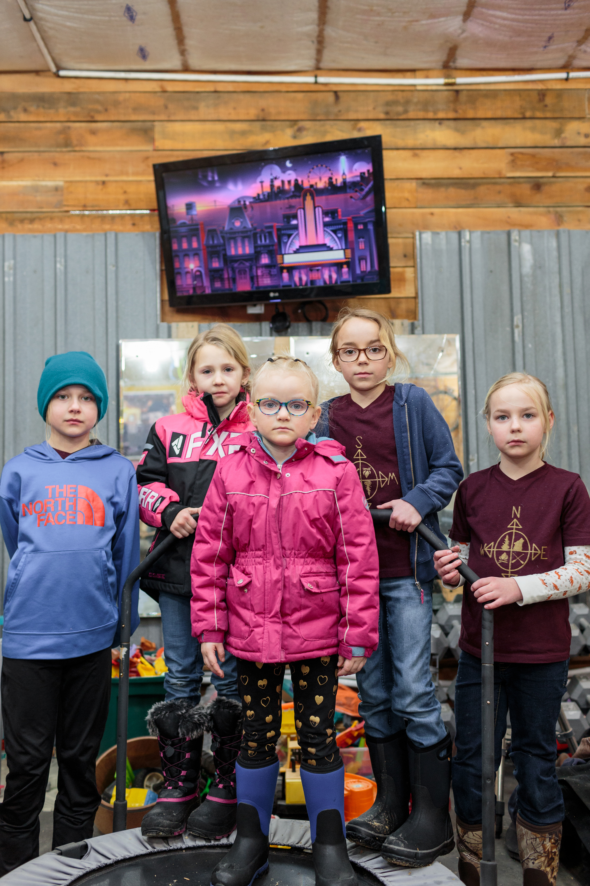 Ava McKeever, Andie McKeever, Iris Knight, Adley Goulet and Emma Goulet stand for a portrait during a weekly  Angle Ladies Adventure Society  in the workshop outside of Sara McGoon, the group leader's home.