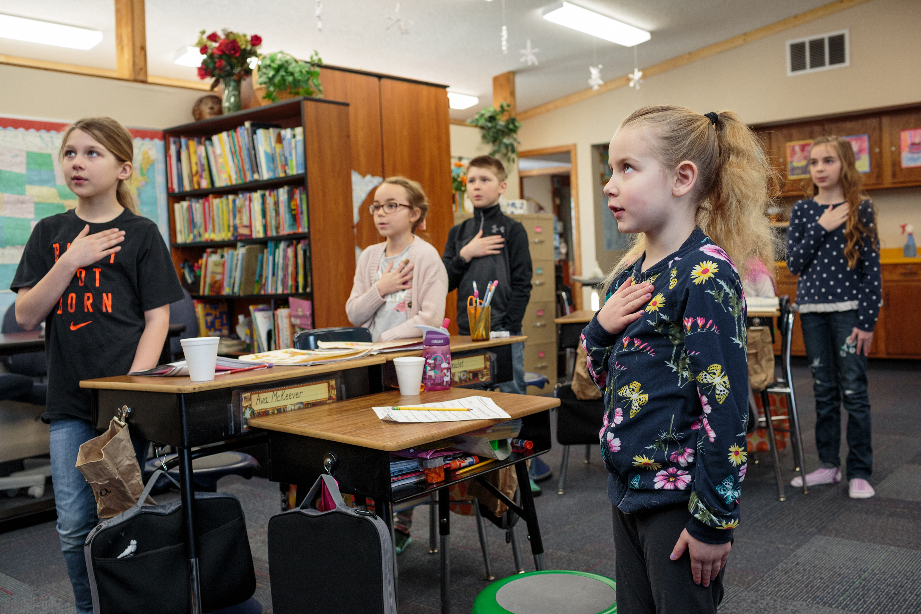Students recite the Pledge of Allegiance at the Angle Inlet School. The school offers personalized studies for the students, allowing the students to structure their own schedule and studies for the day. The Angle Inlet School teaches grades 1-6 for the 100-or so population of the area.