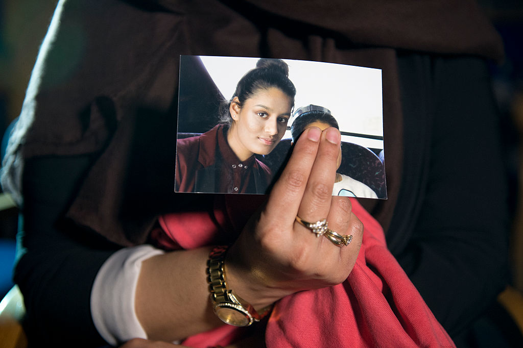 Renu Begum, eldest sister of Shamima Begum, 15, holds her sister's photo as she is interviewed by the media at New Scotland Yard in London, England, on Feb. 22, 2015.