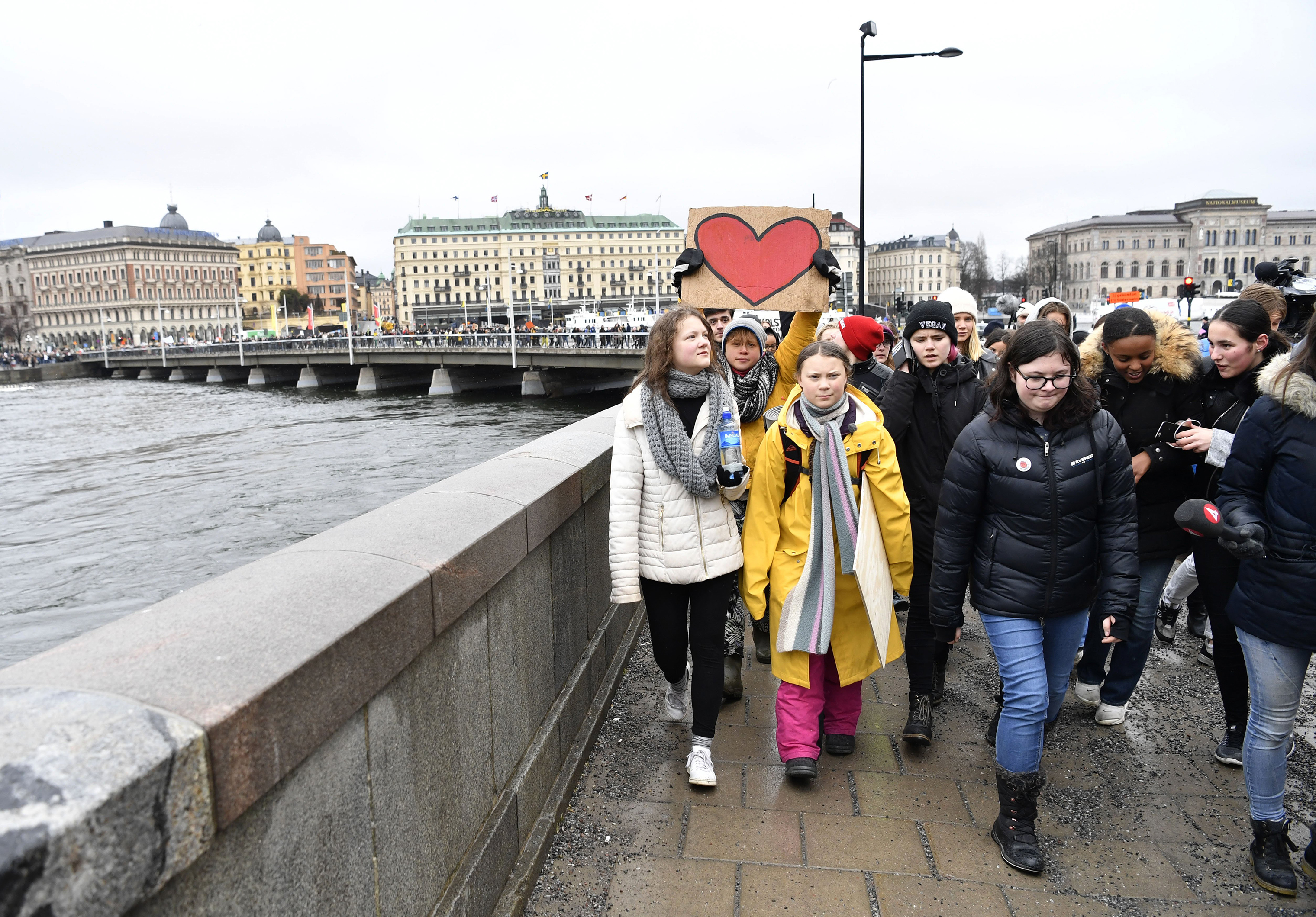 Activist Greta Thunberg, foreground centre, and her sister Beata Thunberg, left, participate in a climate protest, in central Stockholm, Sweden, on March 15, 2019.
