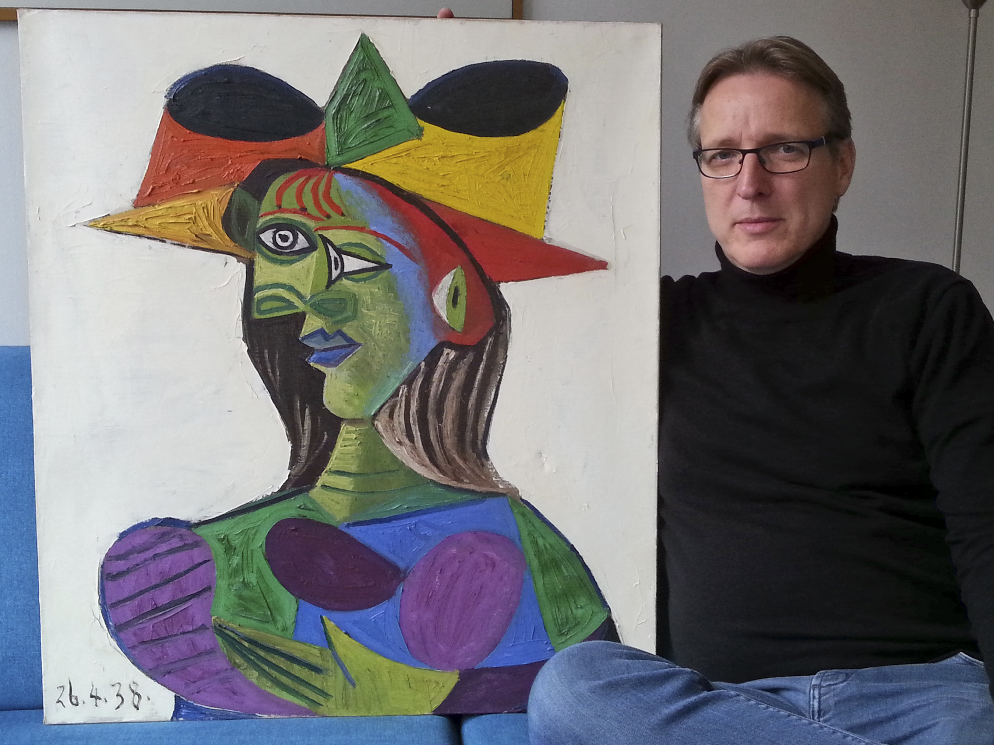 Dutch art detective Arthur Brand sits with  Buste de Femme , a Picasso painting he recently recovered that was stolen from a wealthy Saudi's yacht 20 years ago.