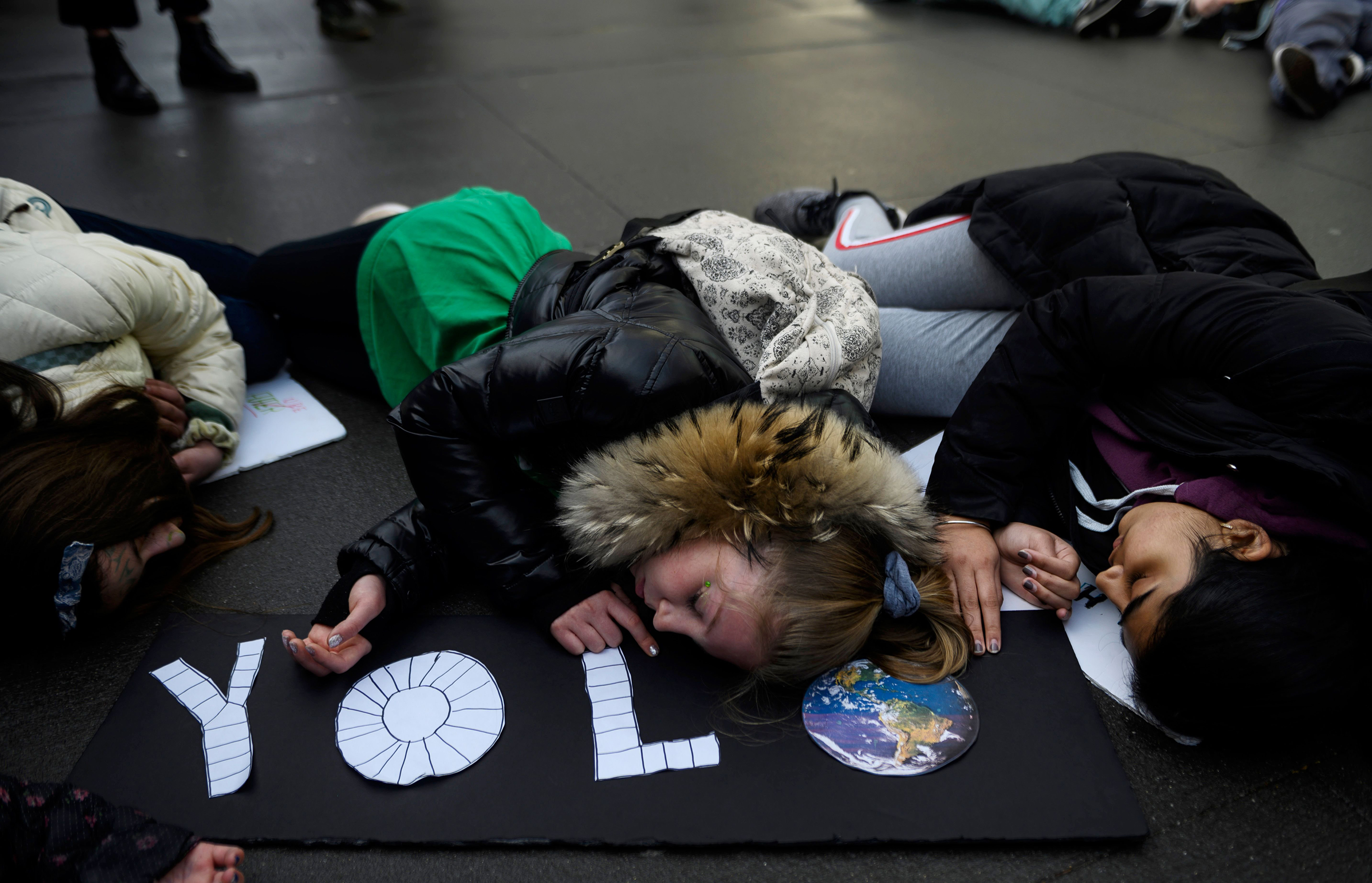 School children taking part on a die-in during a Youth Climate Strike in front of the New York Headquarters of the United Nations on March 15, 2019 in New York City.