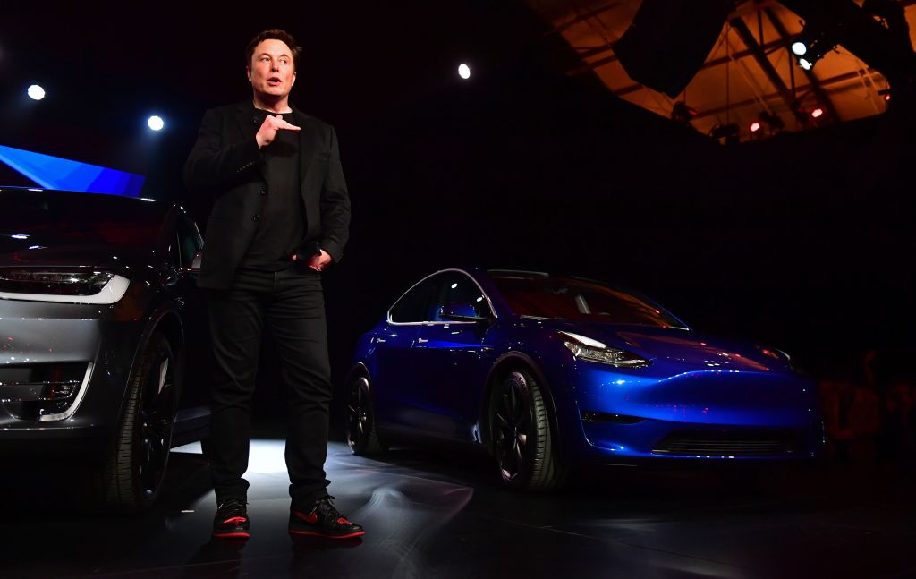 Tesla CEO Elon Musk speaks beside the just unveiled new Tesla Model Y in Hawthorne, California on March 14, 2019.