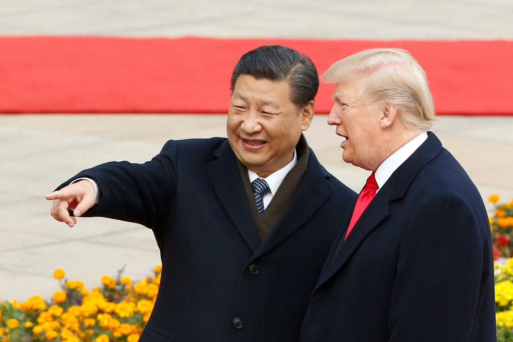 In this file photo, Chinese President Xi Jinping and U.S. President Donald Trump attend a welcoming ceremony Nov. 9, 2017 in Beijing, China. Trump and Jinping are close to finalizing a trade deal between their two nations.