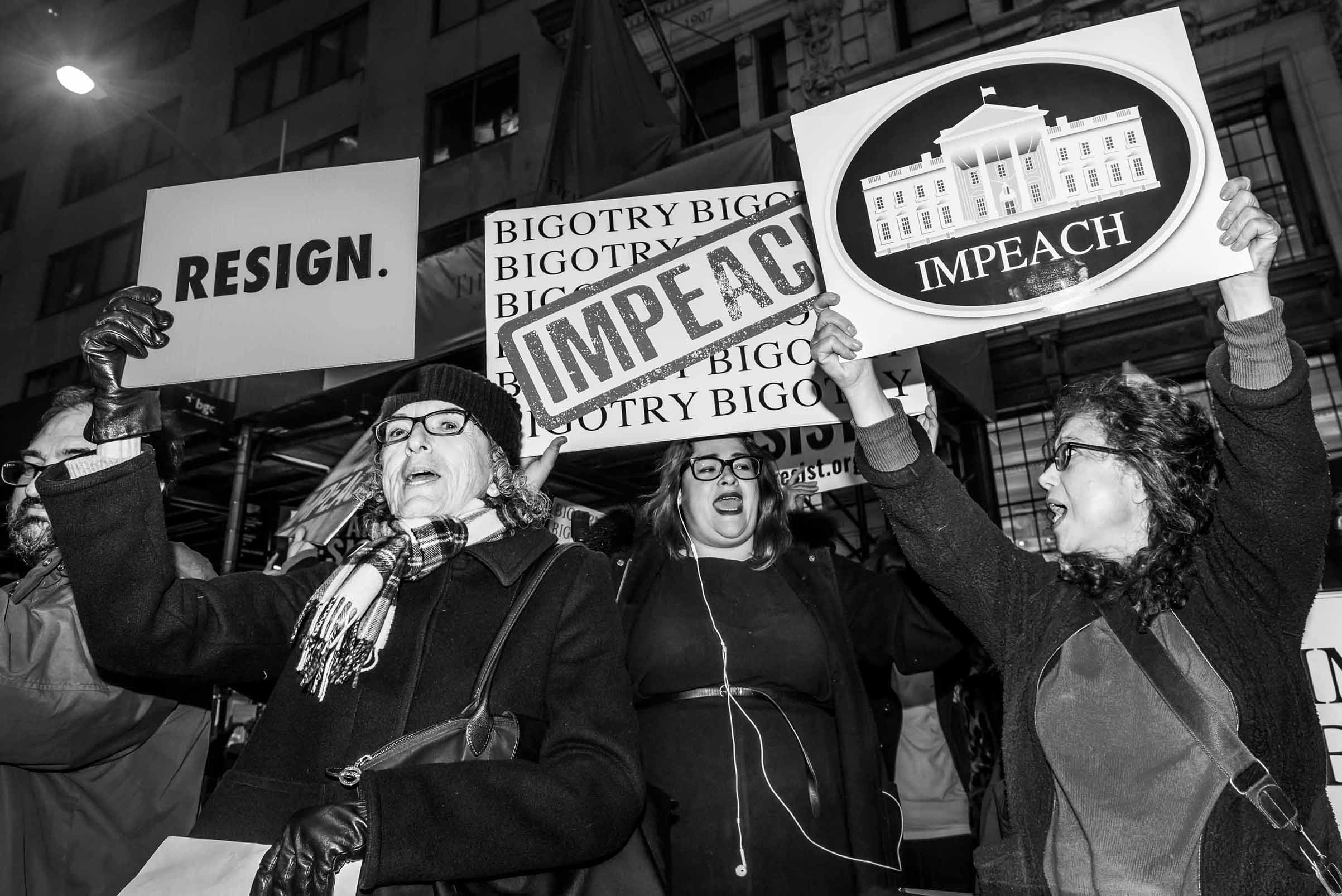 Activists gather outside a Trump-owned building in New York City in 2017 to rally for the President's removal