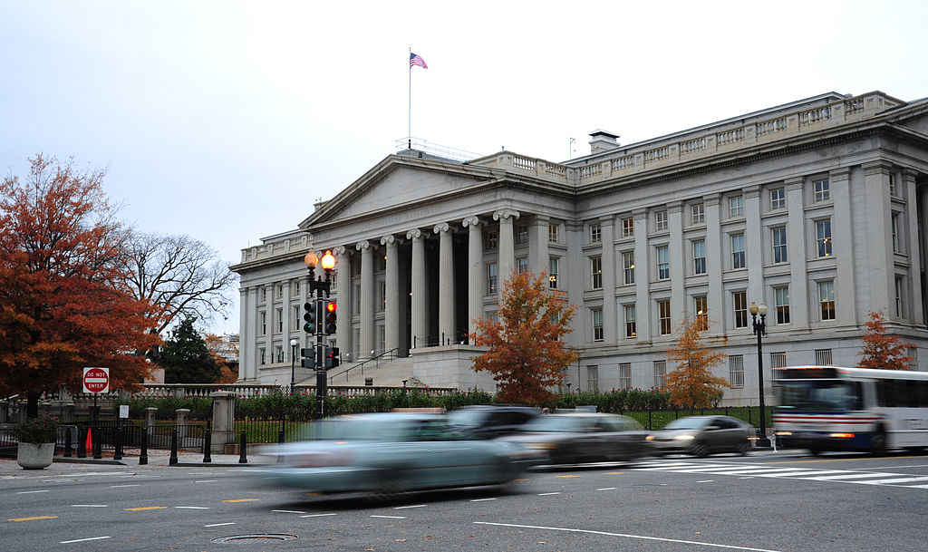 Vehicles drive by the U.S. Treasury Building in Washington, DC on Nov. 15, 2011. On March 21, 2019 a section of the Treasury yield curve turned negative for the first time since the crisis of 2008 signaling a possible recession ahead.