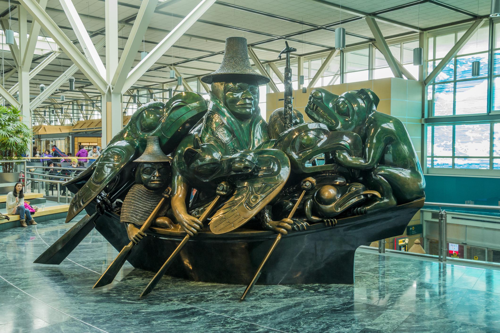 Cast bronze sculpture, The Spirit of Haida Gwaii, the Jade Canoe, by artist Bill Reid in the Vancouver International Airport.