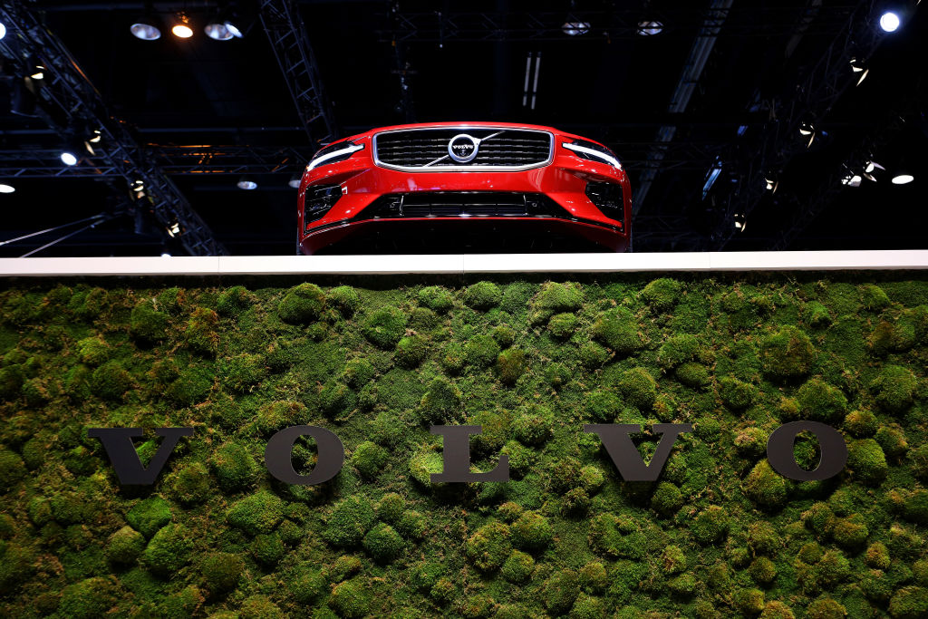 A 2019 Volvo S60 sits atop Volvo signage at the 111th Annual Chicago Auto Show at McCormick Place in Chicago, Illinois on February 7, 2019.