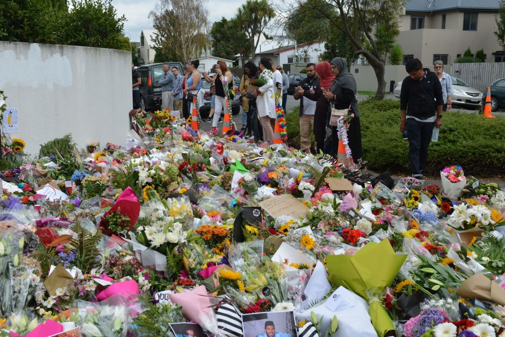 People place flowers at memorial sites as a tribute to victims of the Fridays terrorist attacks on two mosques that left at least 50 people killed in Christchurch, New Zealand on March 19, 2019.