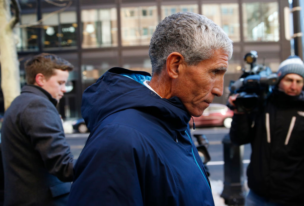 William  Rick  Singer leaves the John Joseph Moakley United States Courthouse in Boston on March 12, 2019. Fifty people have been arrested nationwide in what authorities are calling the largest college admissions scam ever, including 33 parents and a California businessman who allegedly collected $25 million in bribes to get students into some of the natiions top colleges, federal prosecutors in Boston said. Singer, 58, described by Boston U.S. Attorney Andrew E. Lelling as the central defendant in the scheme, allegedly collected the bribes.