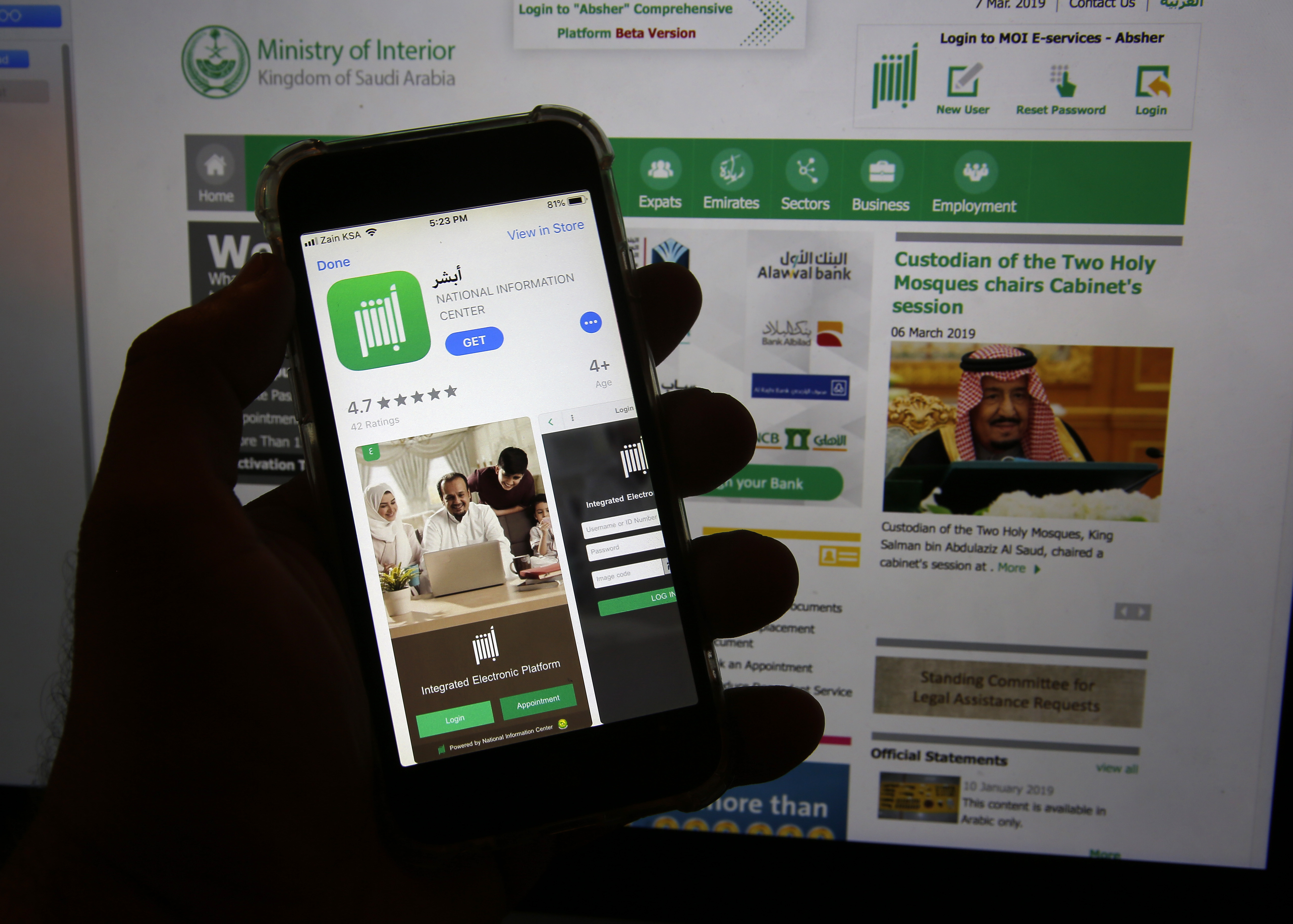 The Absher app is seen on a phone in Jiddah, Saudi Arabia on March 7, 2019.