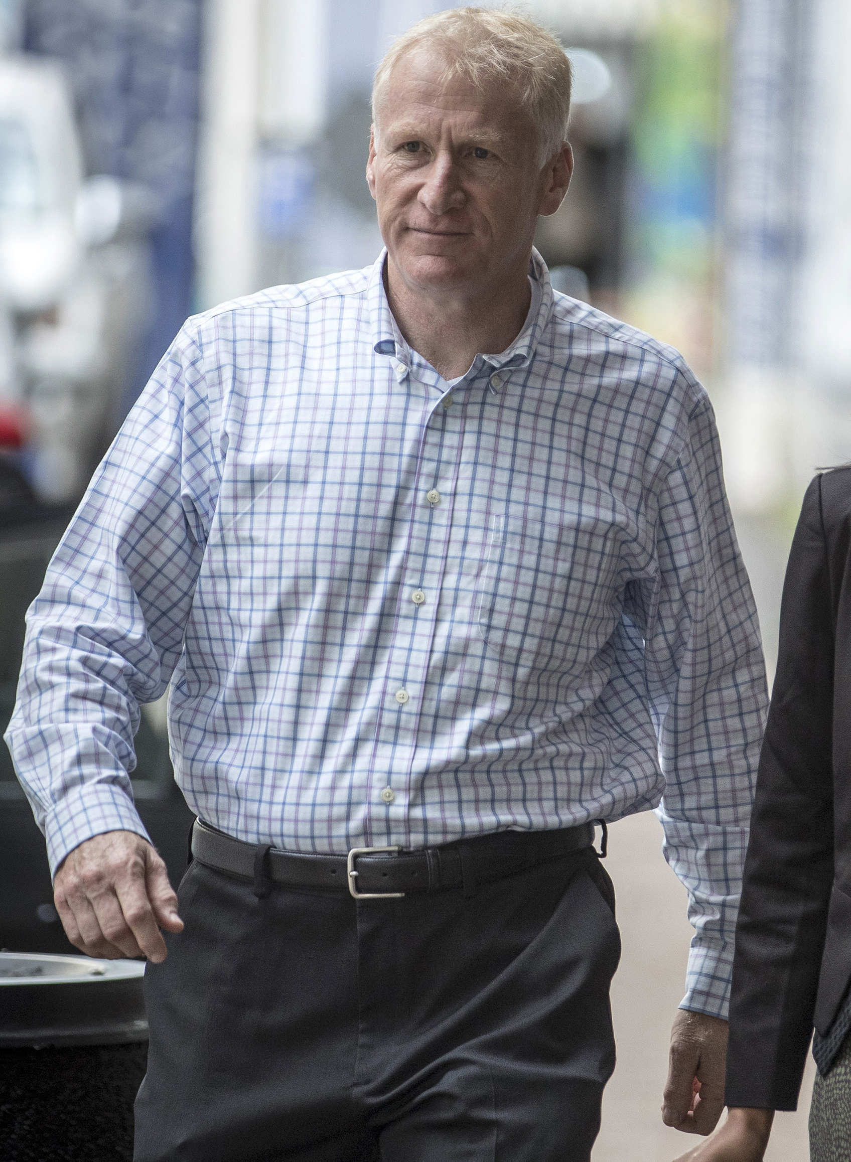 Alfred Keating, a former New Zealand Navy commodore and senior defense attache, walks towards the Auckland District Court on March 29, 2018.