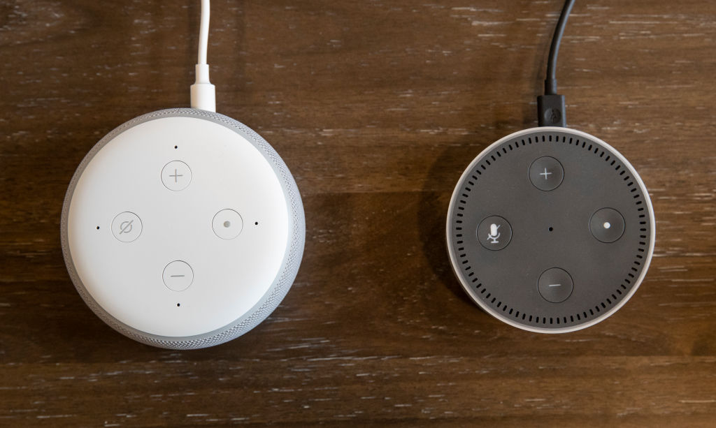 An updated  Echo Dot  (L) is pictured next to an older generation  Echo Dot  at Amazon Headquarters, following a launch event, on September 20, 2018 in Seattle Washington.
