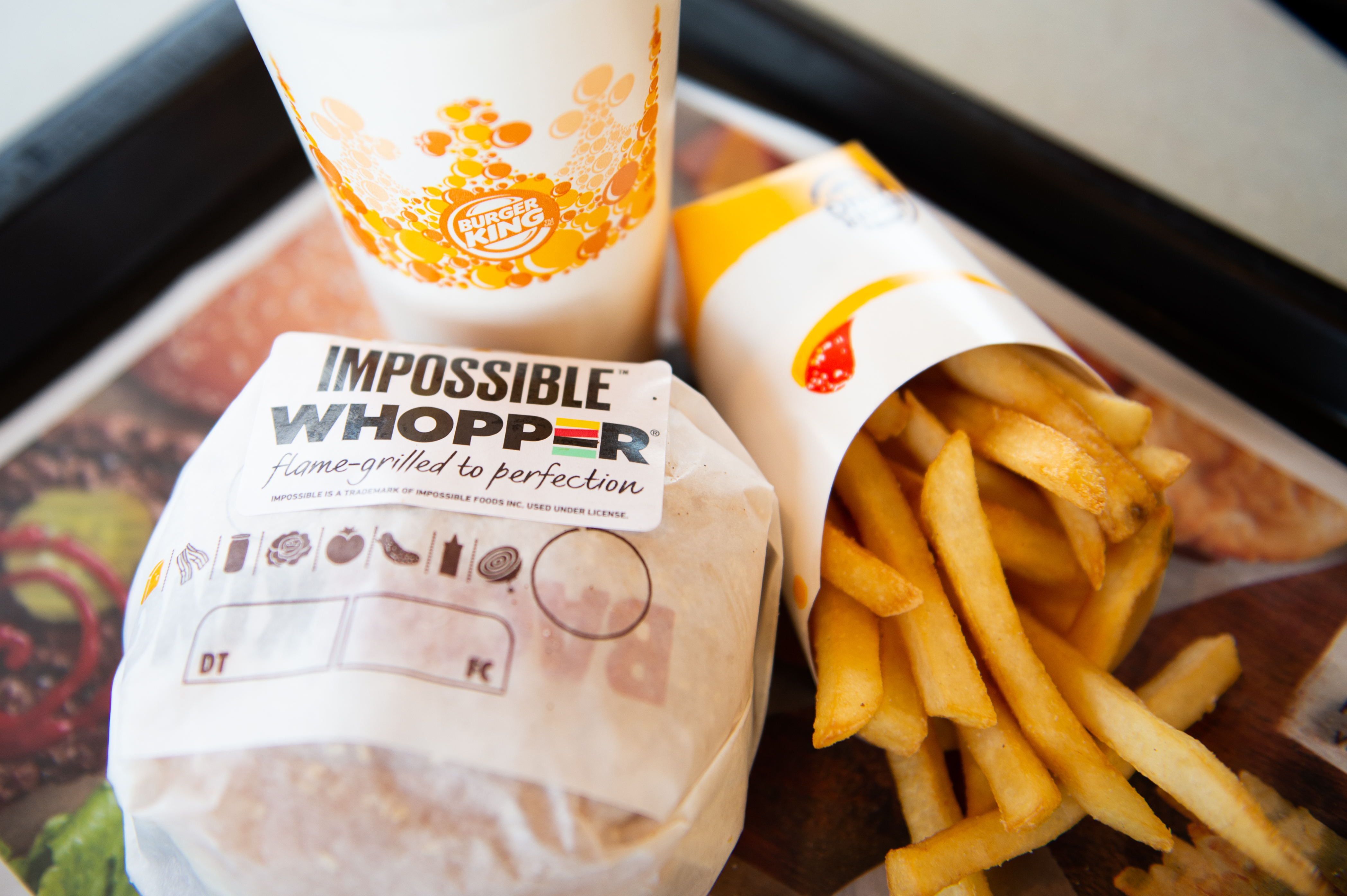 In this photo illustration, an 'Impossible Whopper' sits on a table at a Burger King restaurant on April 1, 2019 in Richmond Heights, Missouri.