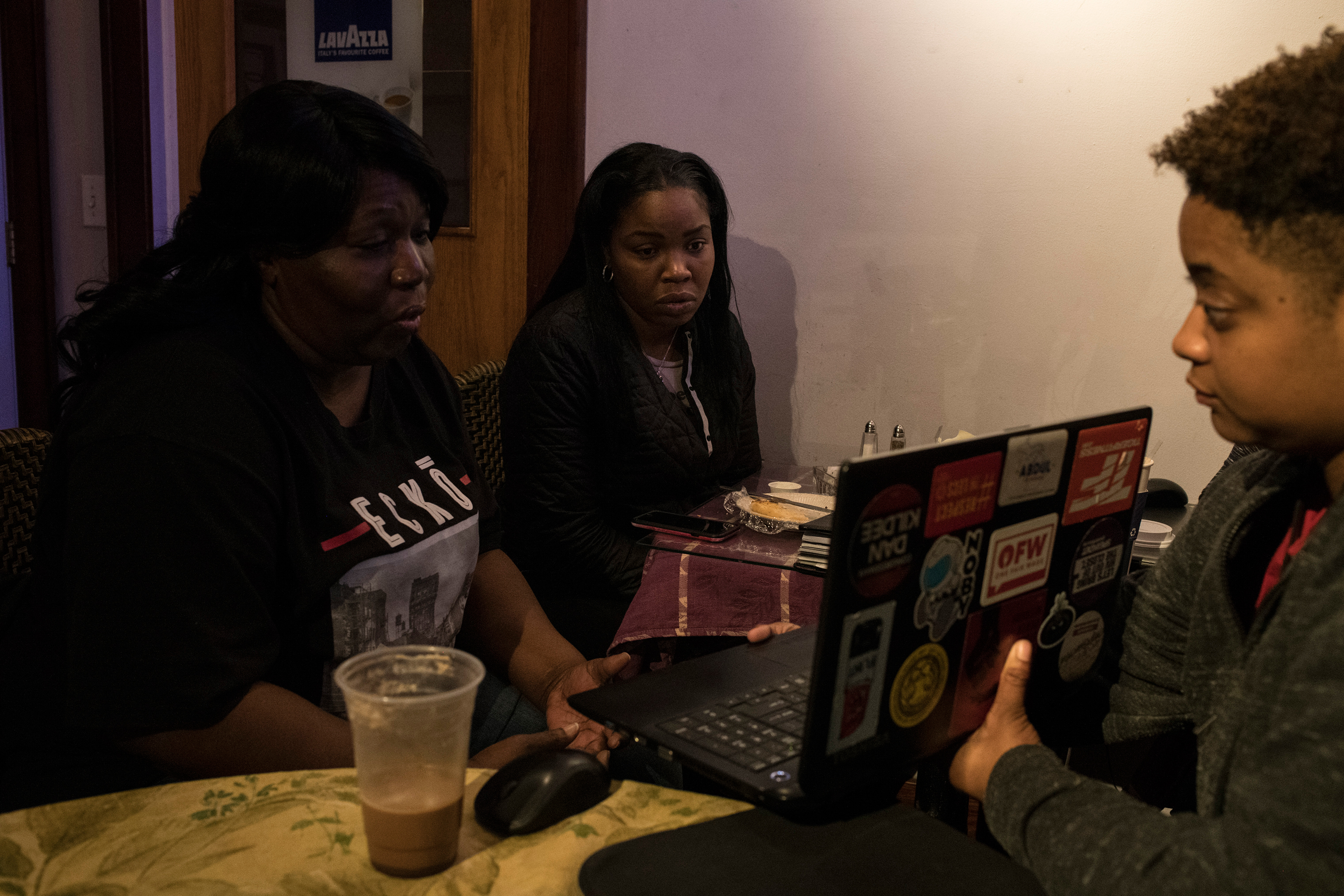 Hawk joins a conference call with a non-profit alongside fellow Flint residents to discuss the needs of the city.