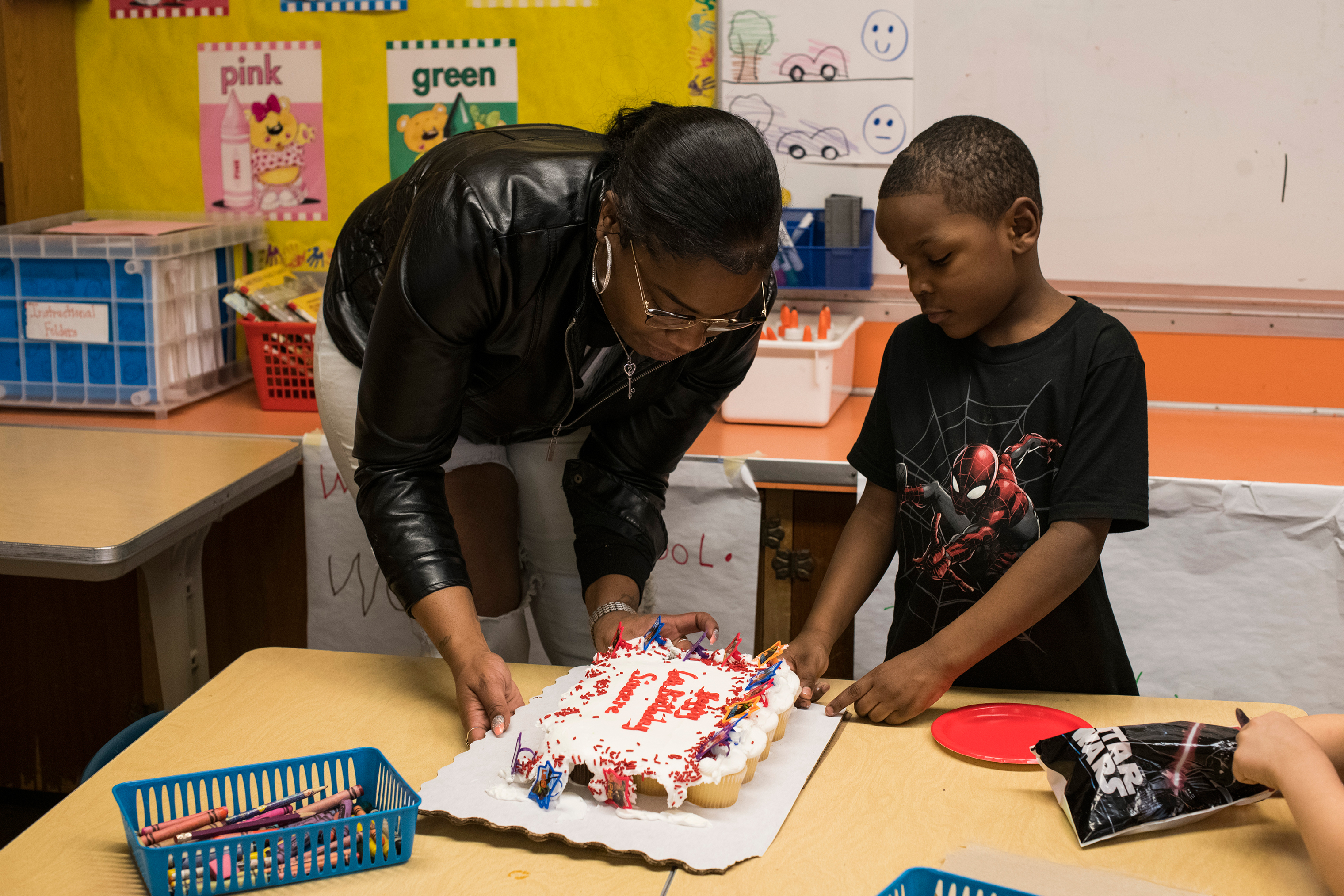 Sincere helps distribute the cupcakes that Hawk brought him and his kindergarten classmates during snack time on Feb. 4.