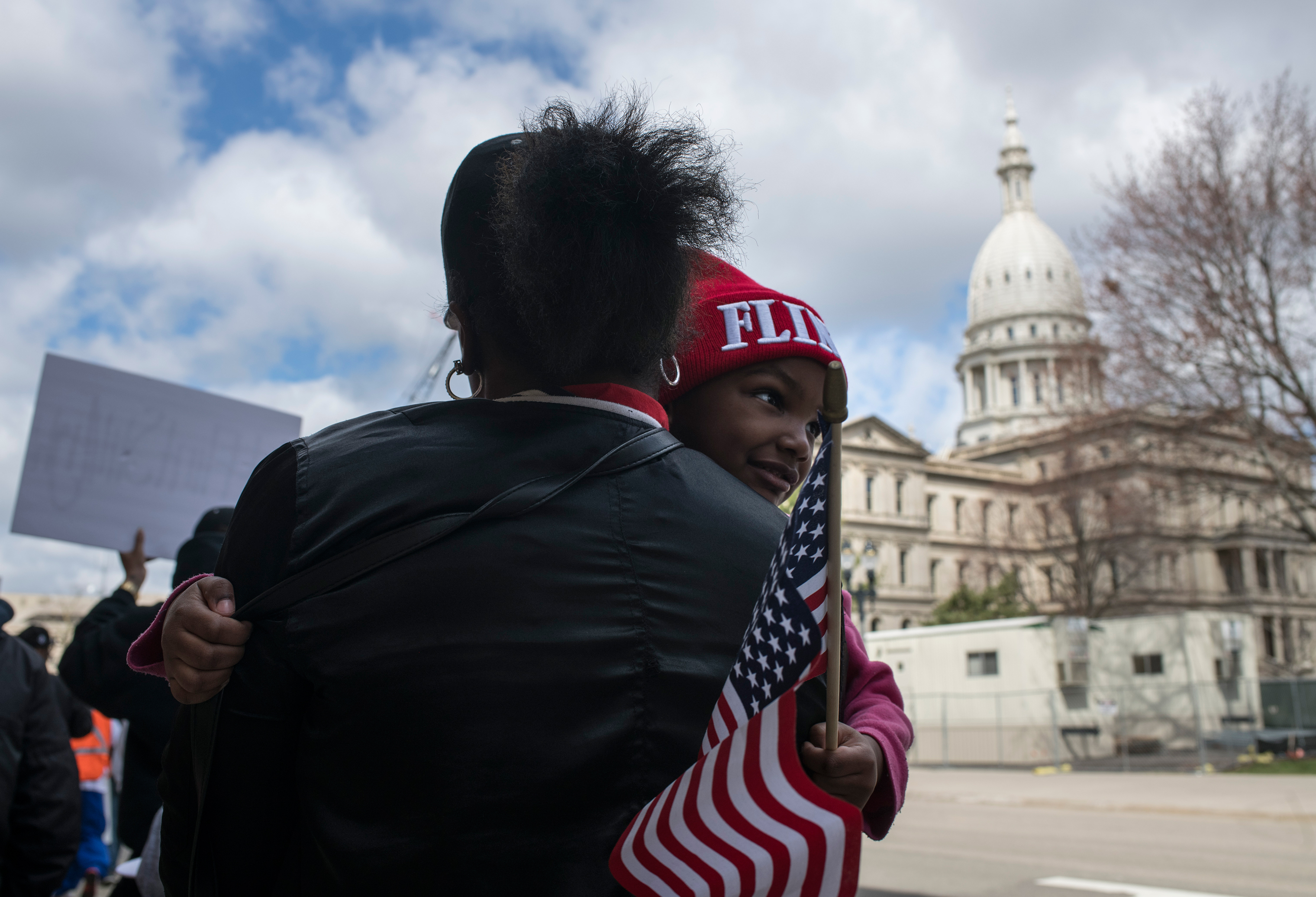 On the fourth anniversary of the water switch that caused the lead pollution, Hawk and daughter Aliana joined other Flint residents last year protesting at the Michigan state capitol.