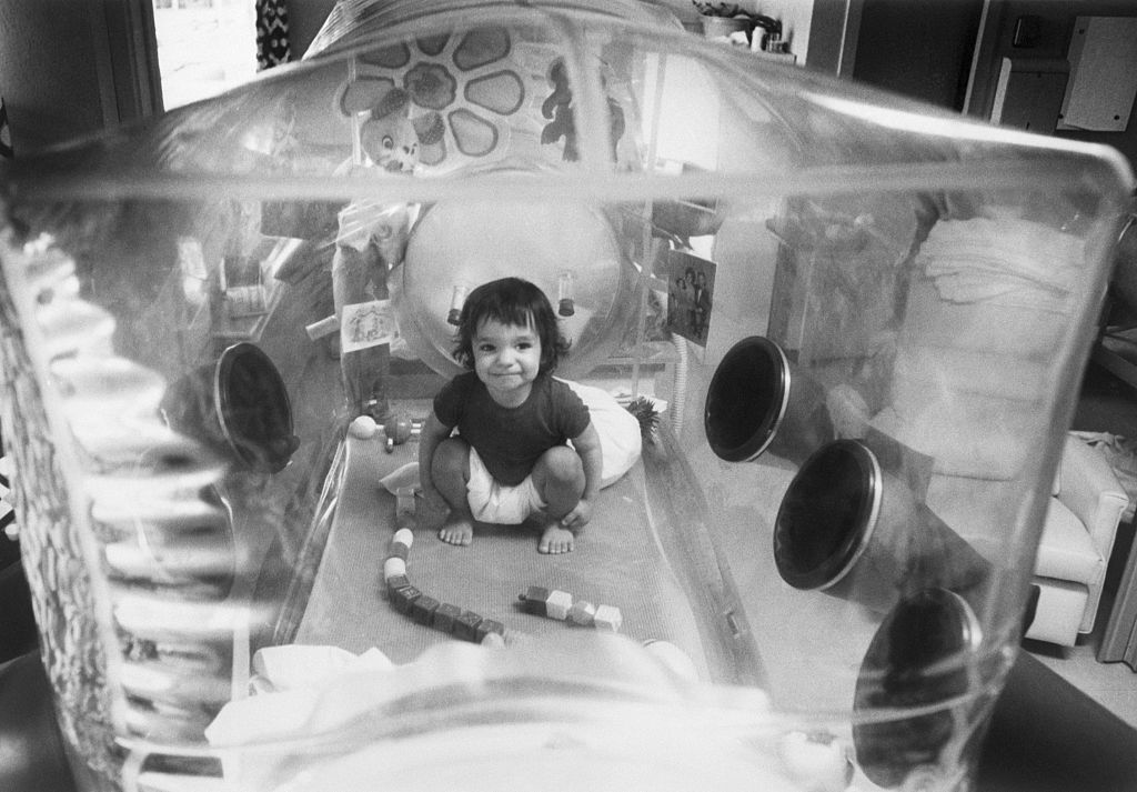 David Vetter, born with immune deficiency syndrome, in his enclosed plastic environment in 1973.