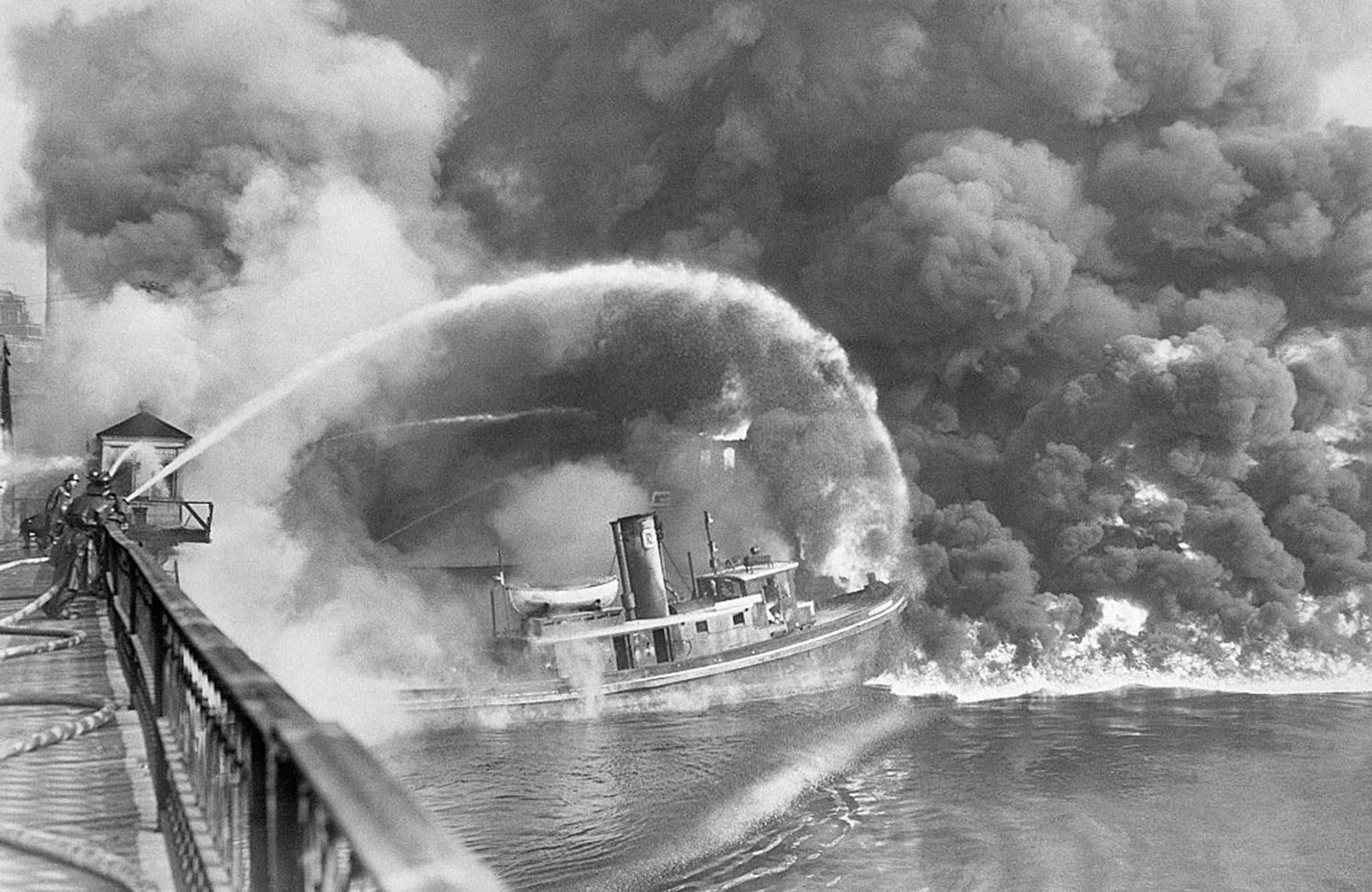 Firemen trying to put out a 1952 blaze on the Cuyahoga River.