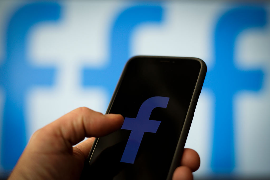 The Facebook logo is seen on an Apple iPhone in this photo illustration in Warsaw, Poland on April 25, 2019. (Jaap Arriens—NurPhoto/Getty Images)