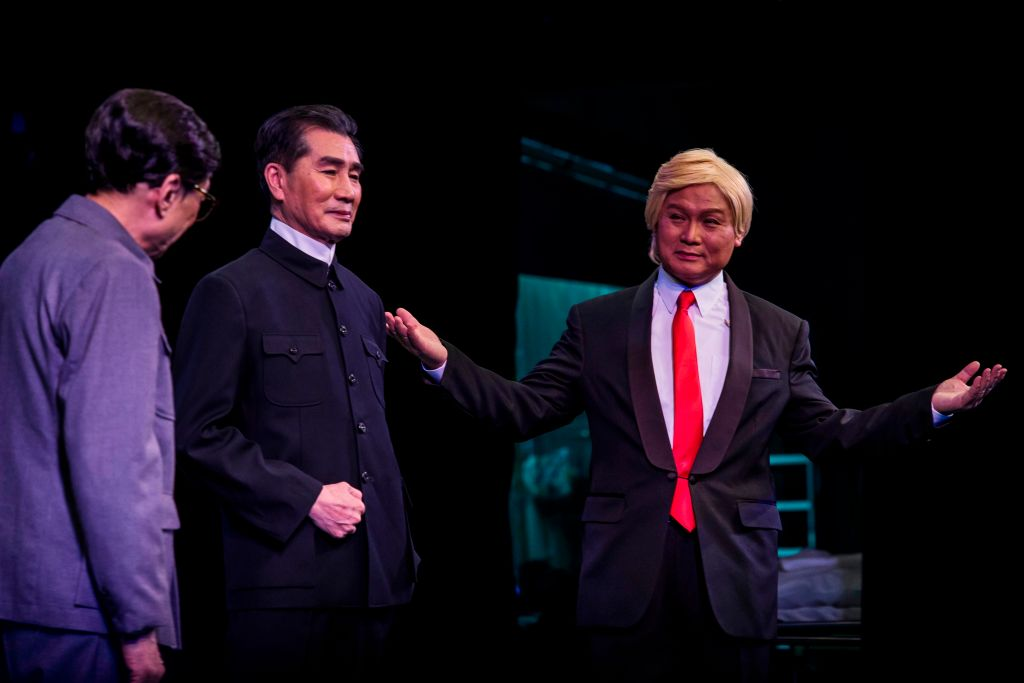Actor Lung Koon-tin, dressed as U.S. President Donald Trump, performs on stage during a rehearsal of a Cantonese opera called 'Trump on Show', in Hong Kong on April 11, 2019.