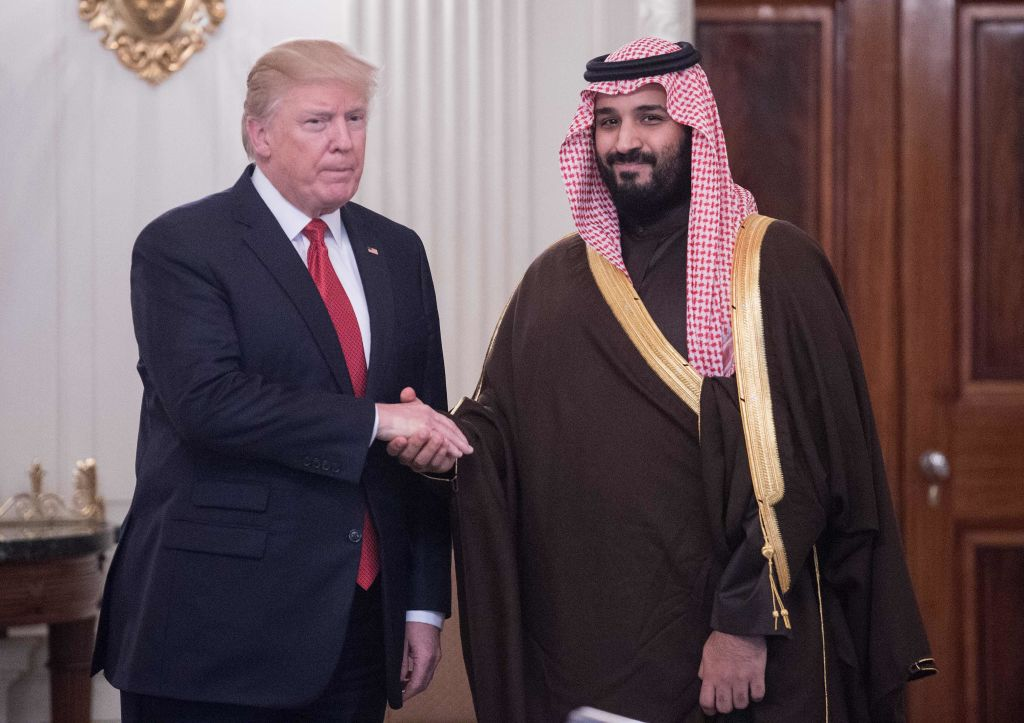 President Donald Trump and Saudi Crown Prince and Defense Minister Mohammed bin Salman shake hands before lunch at the White House in Washington, DC, on March 14, 2017.