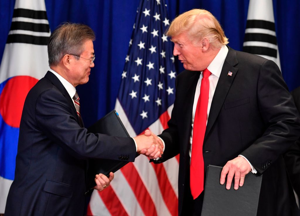 US President Donald Trump (R) and South Korean President Moon Jae-in shake hands after signing a trade agreement at a bilateral meeting in New York on September 24, 2018, a day before the start of the General Debate of the 73rd session of the General Assembly.