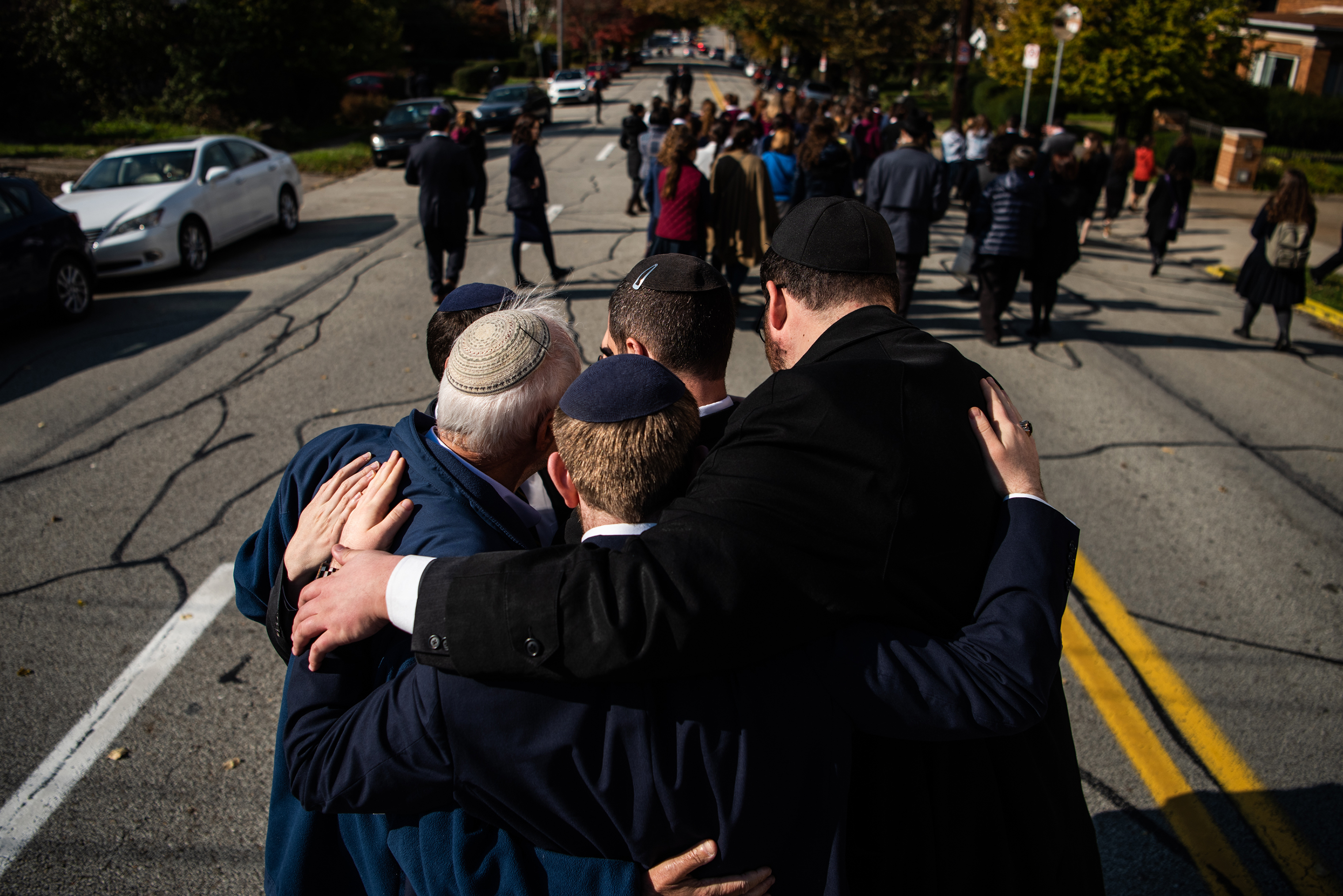 Mourners embrace at the funeral of Joyce Fienberg who was killed at the mass shooting at the Tree of Life Synagogue on Oct. 31, 2018, in Pittsburgh, PA.