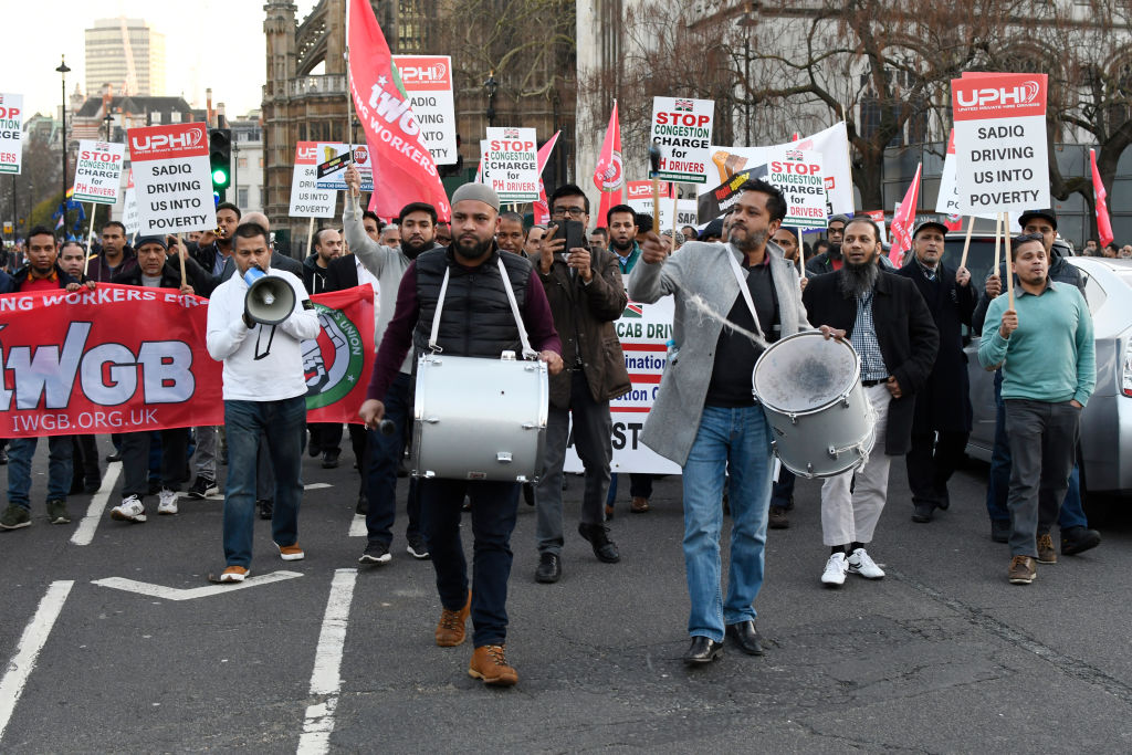 Minicab drivers block London's Parliament Square in protest over changes to the congestion charge on February 25, 2019