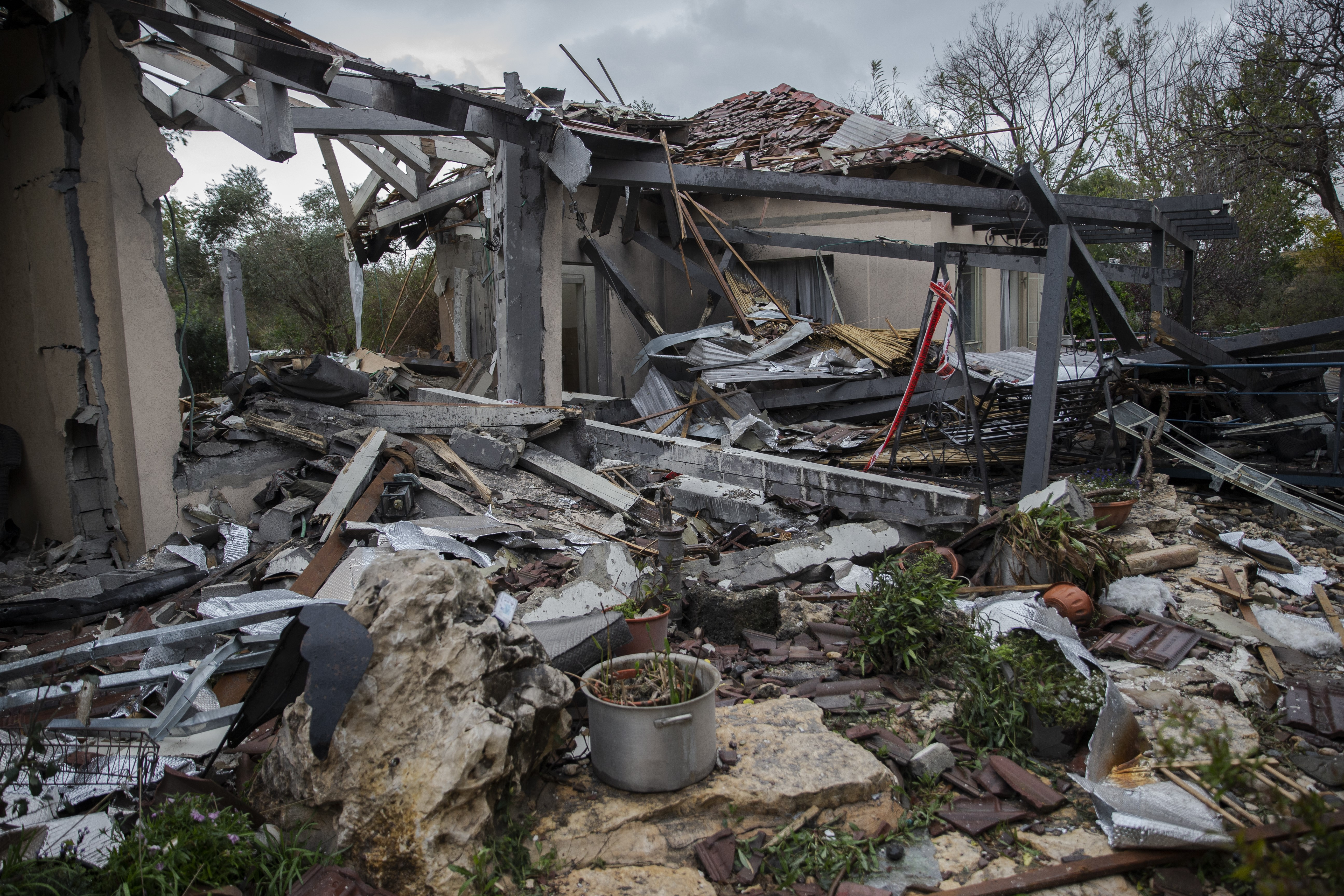 Damaged houses are seen after a rocket hit the village of Mishmeret on March 25, 2019. Seven Israelis were reportedly injured in rocket fire from the Gaza Strip.